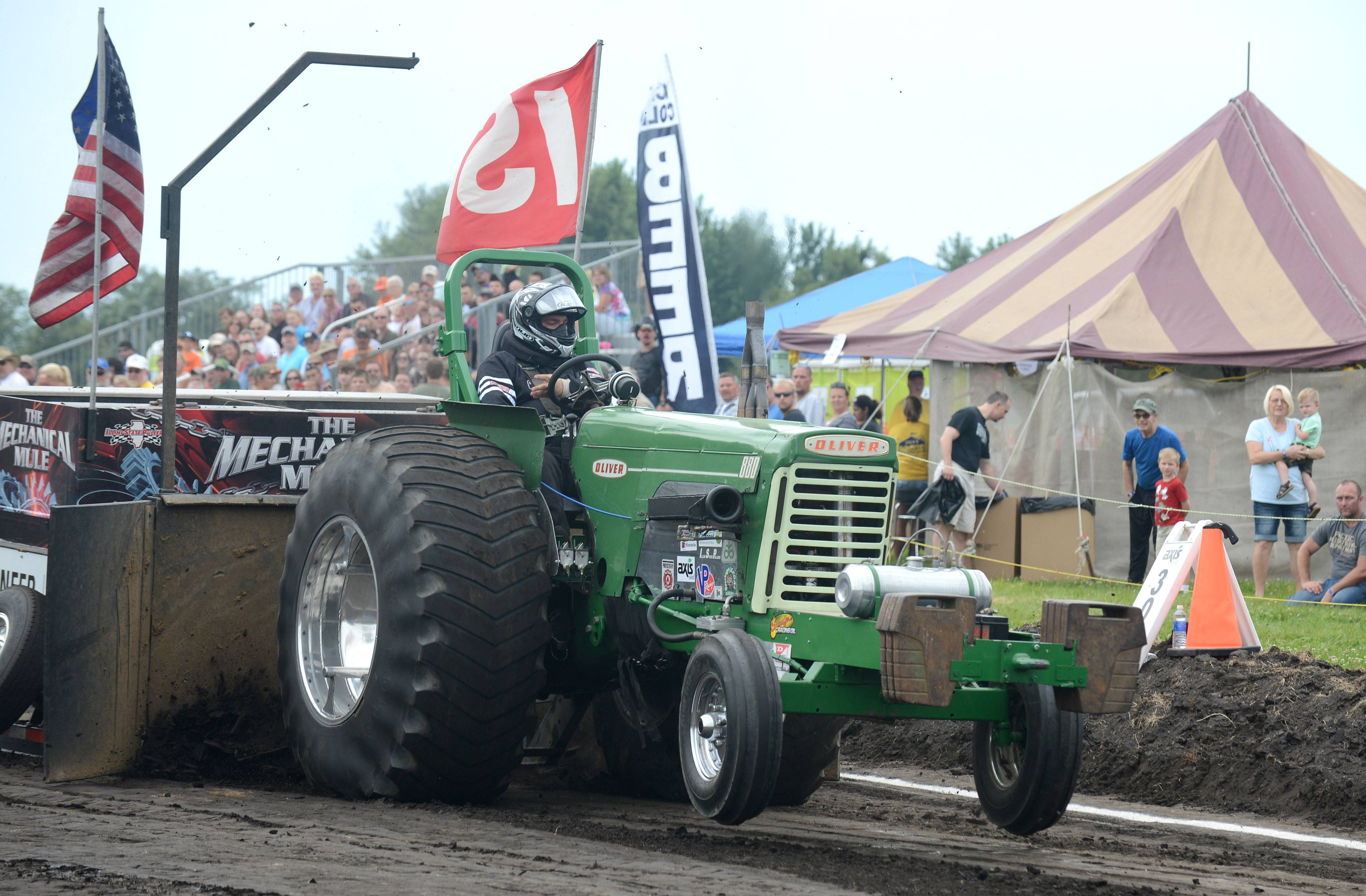 Mike Sauter of Tonica races his '58 Super Oliver 880 tractor in the 5,000 NA SS class at the truck and tractor pull at Elburn Days Saturday.
