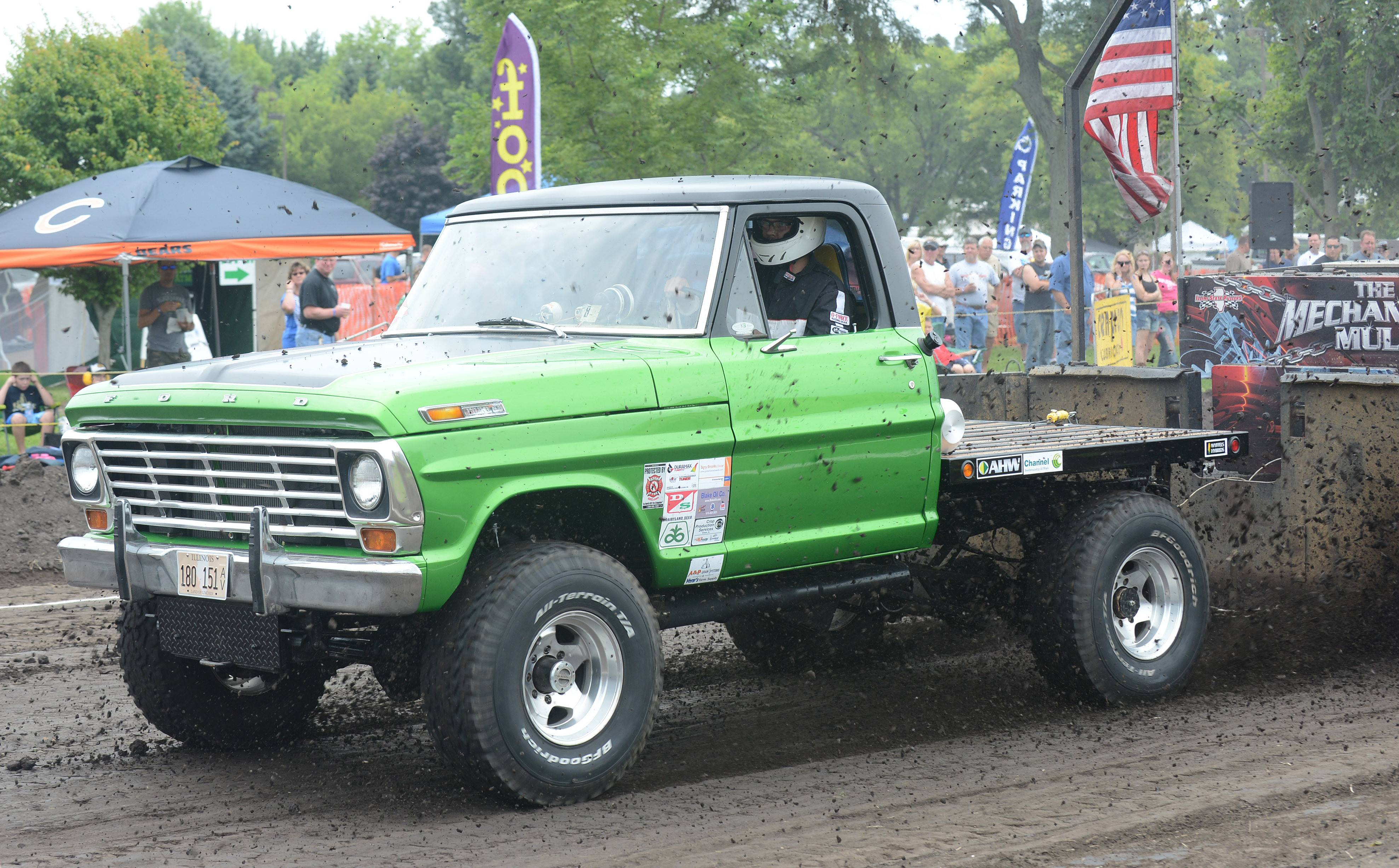 Evan Olson of Maple Park competes in the 6,500 AS 4 x 4 truck class with his '68 Ford F250 at Elburn Days Saturday.