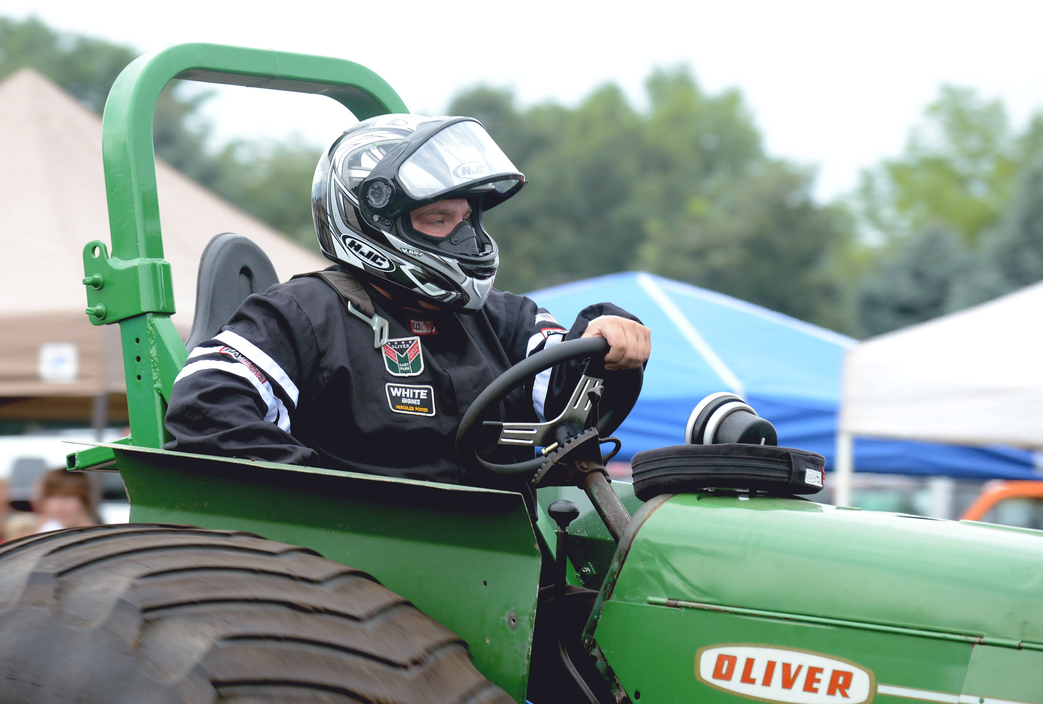 Mike Sauter of Tonica leaves the racetrack with his '58 Oliver Super 880 at the Elburn Days tractor pull on Saturday.