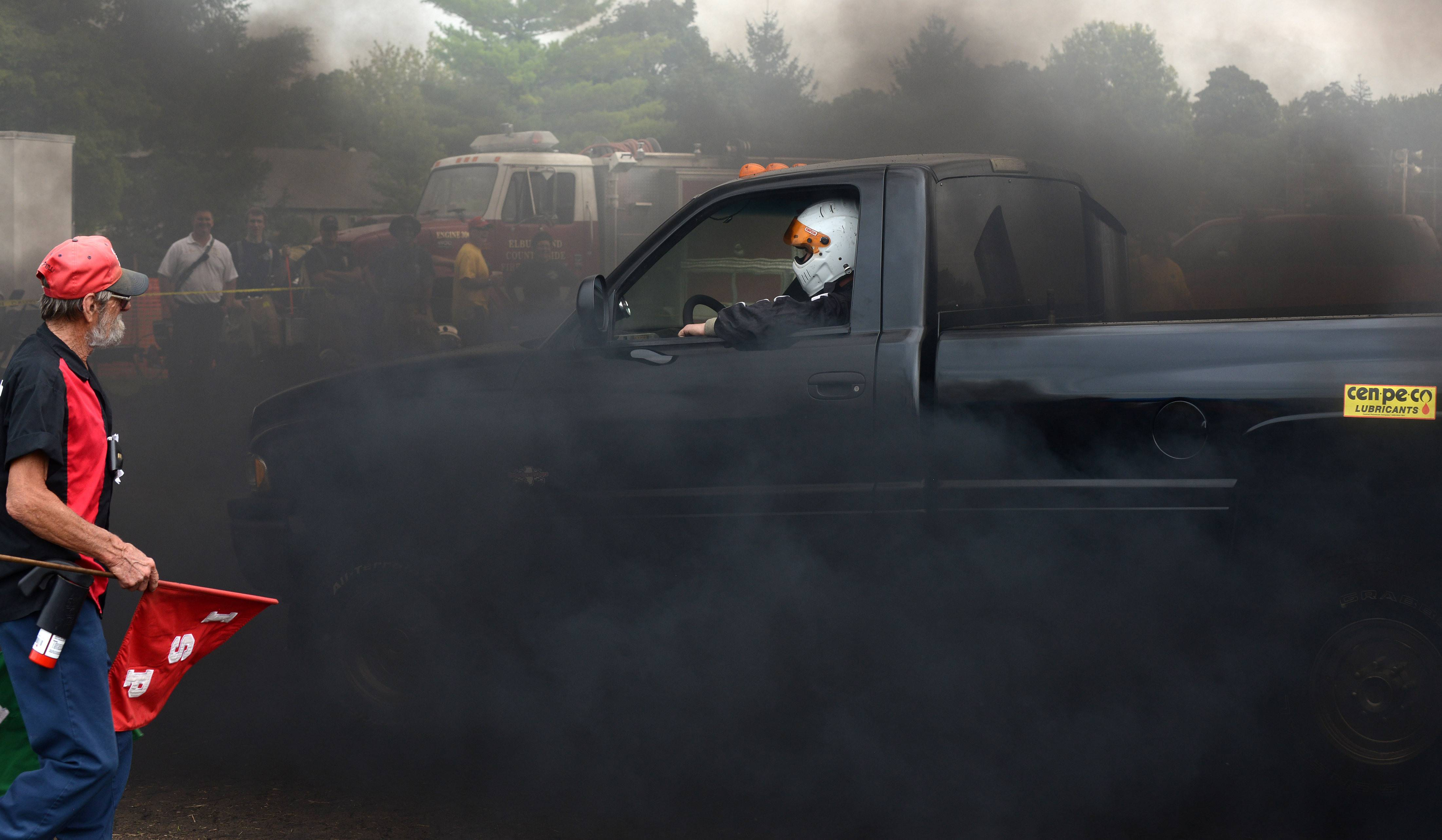Diesel smoke clears after Chris Lemke of Sheridan finishes competing in the 6,500 AS 4 x 4 class with his '95 Dodge truck at Elburn Days Saturday.
