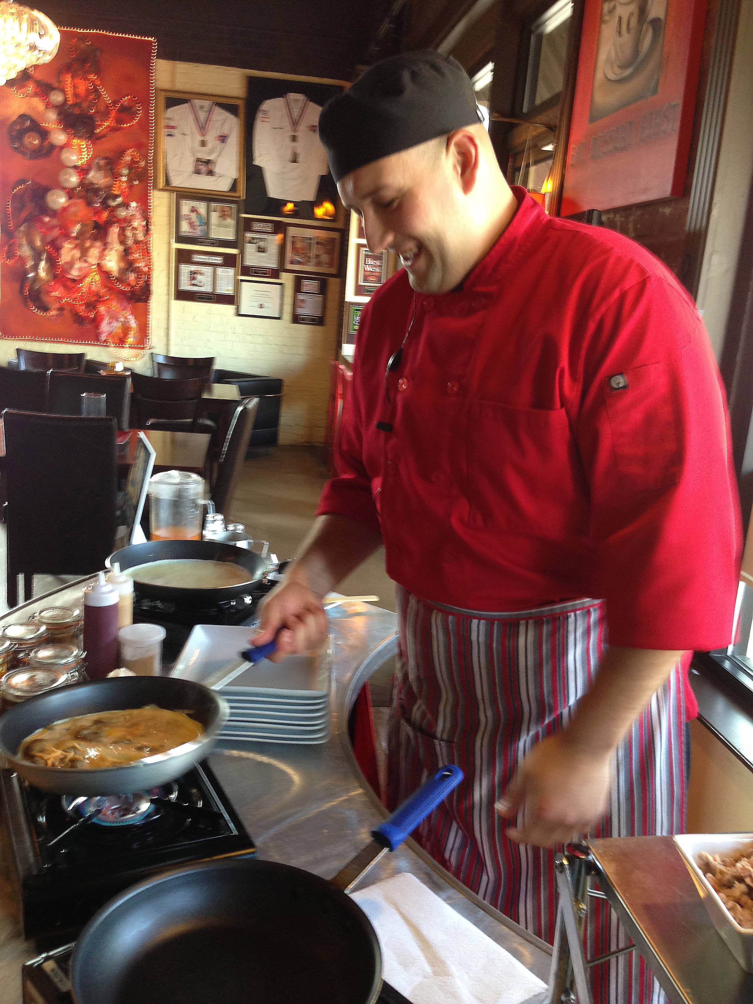 Chef Andrew Zika makes omelets in the dining room at All Chocolate Kitchen along Third Street in Geneva on a recent Sunday morning.