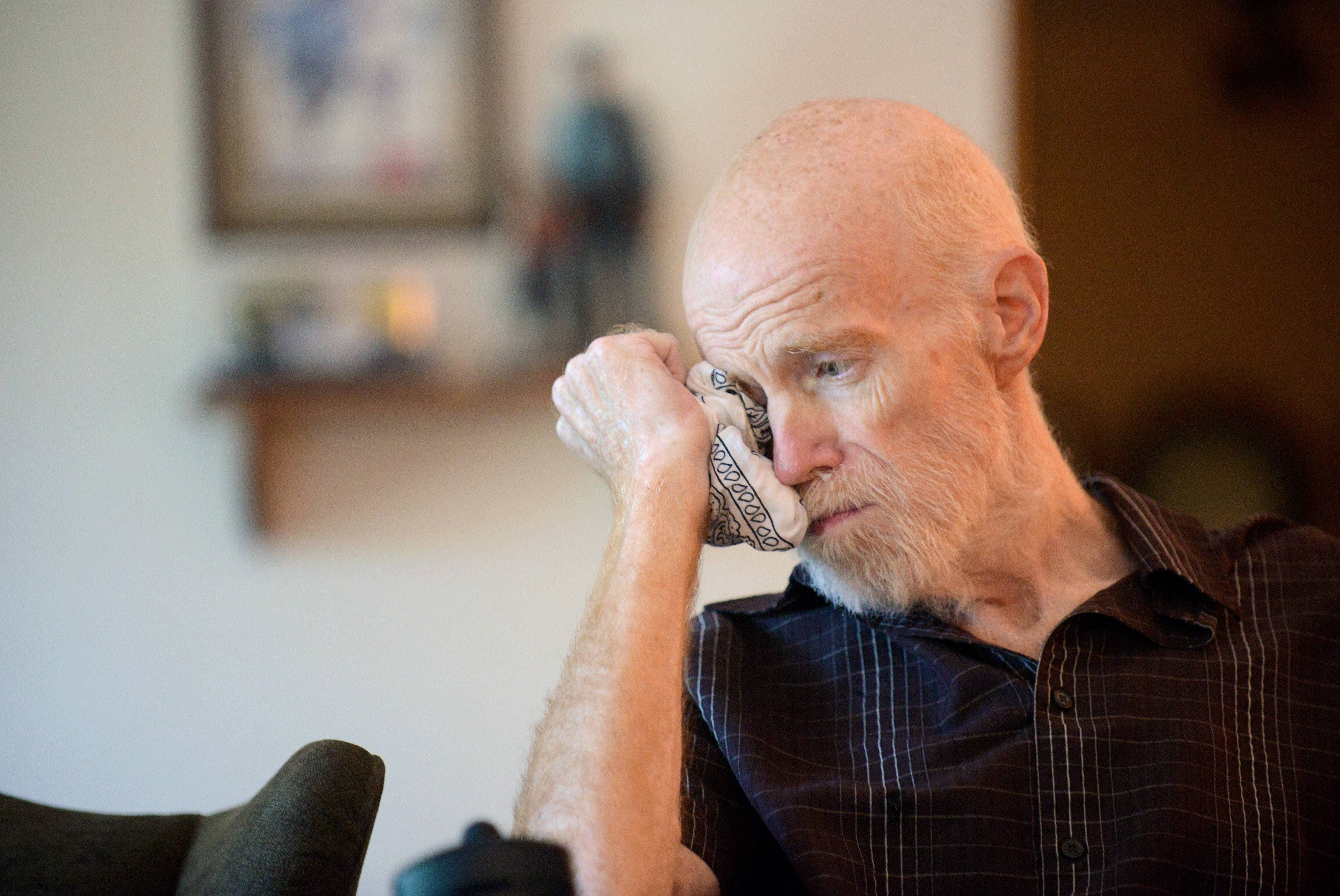 Retired Elgin police Sgt. Tom Linder wipes tears away as his wife, Dawn, tells the story of how she knew she'd always have faith in his recovery. He suffered a stroke in May 2012.