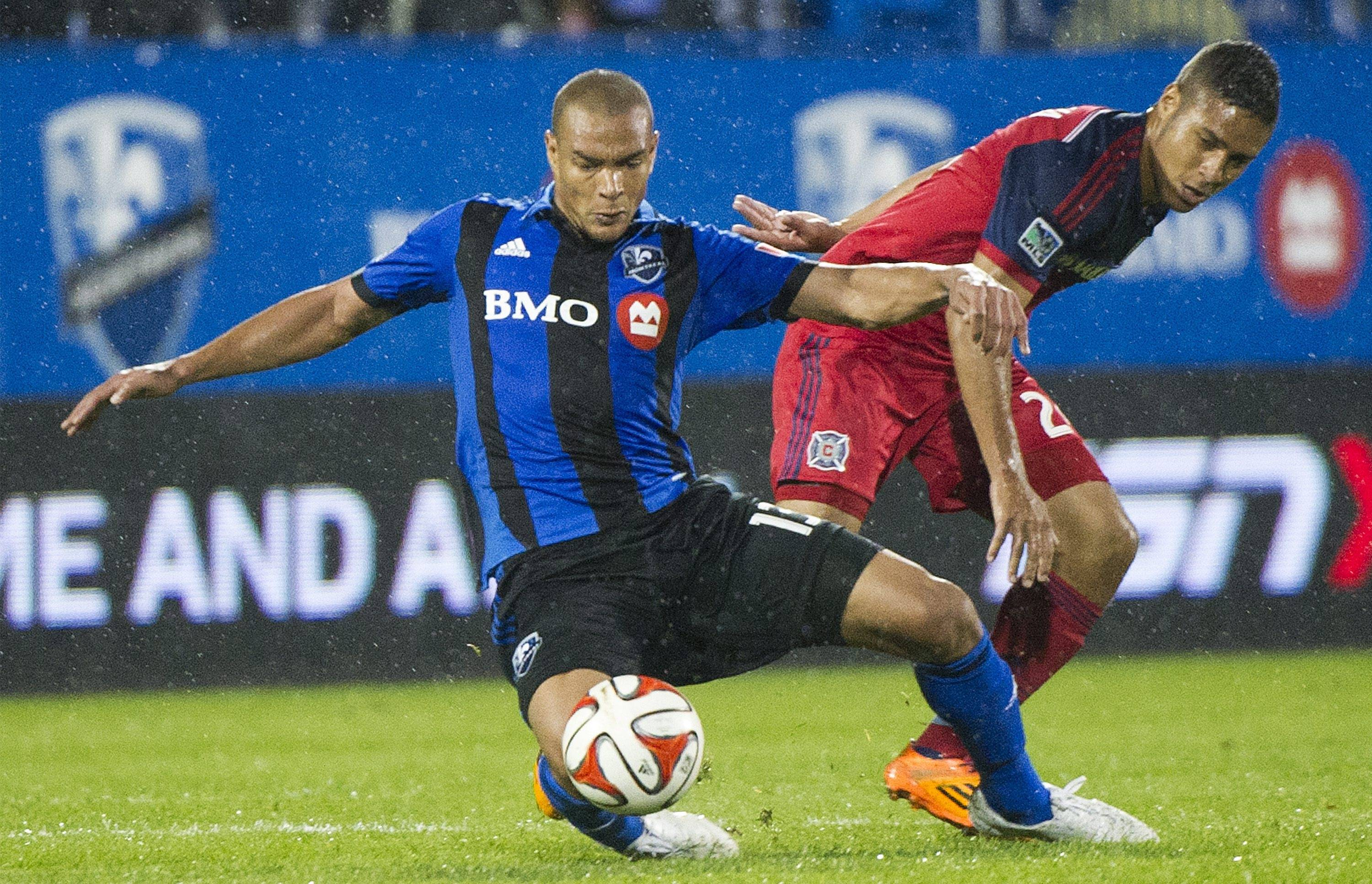 The Montreal Impact's Matteo Ferrari, left, and Chicago Fire's Quincy Amarikwa vie for the ball during Saturday's match in Montreal. The Impact won 1-0, breaking a 7-game losing streak.