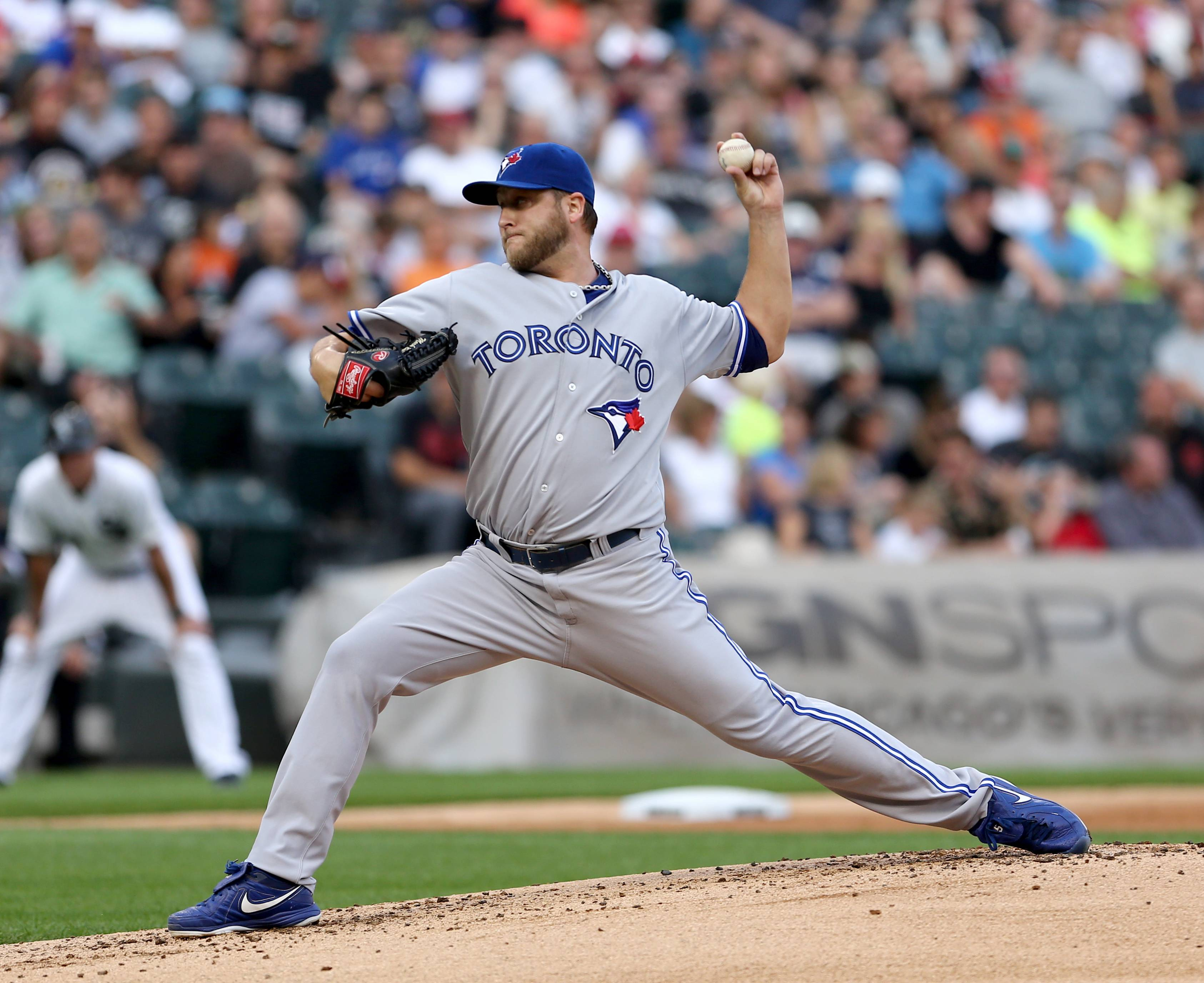 Toronto Blue Jays starter Mark Buehrle pitches to the Chicago White Sox in the first inning in a baseball game in Chicago on Saturday, Aug. 16, 2014.