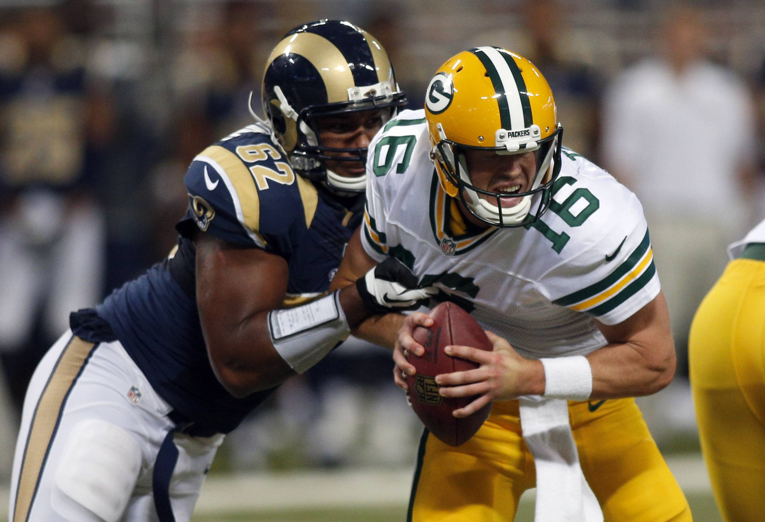 Green Bay Packers quarterback and Fremd alumni Scott Tolzien, right, is sacked for a 1-yard loss by St. Louis Rams defensive tackle Ethan Wesbrooks during Saturday's preseason game in St. Louis. The Packers won 21-7.