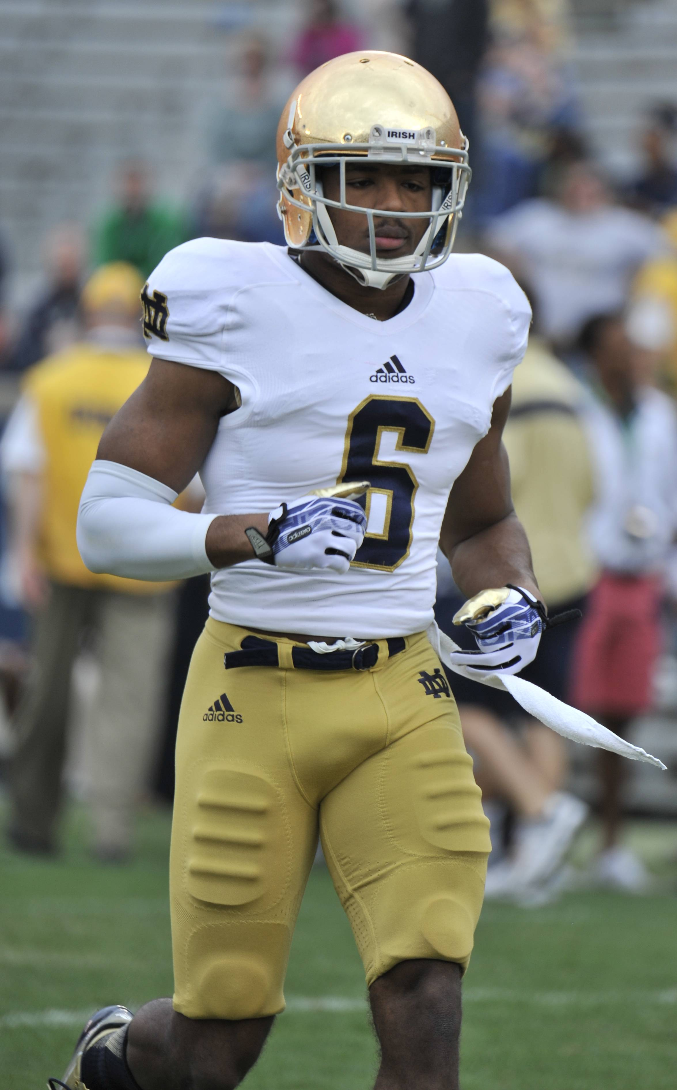Notre Dame cornerback KeiVarae Russell and three other players are being withheld from practices and games until the university completes an investigation into whether papers and homework they turned in were completed by others.