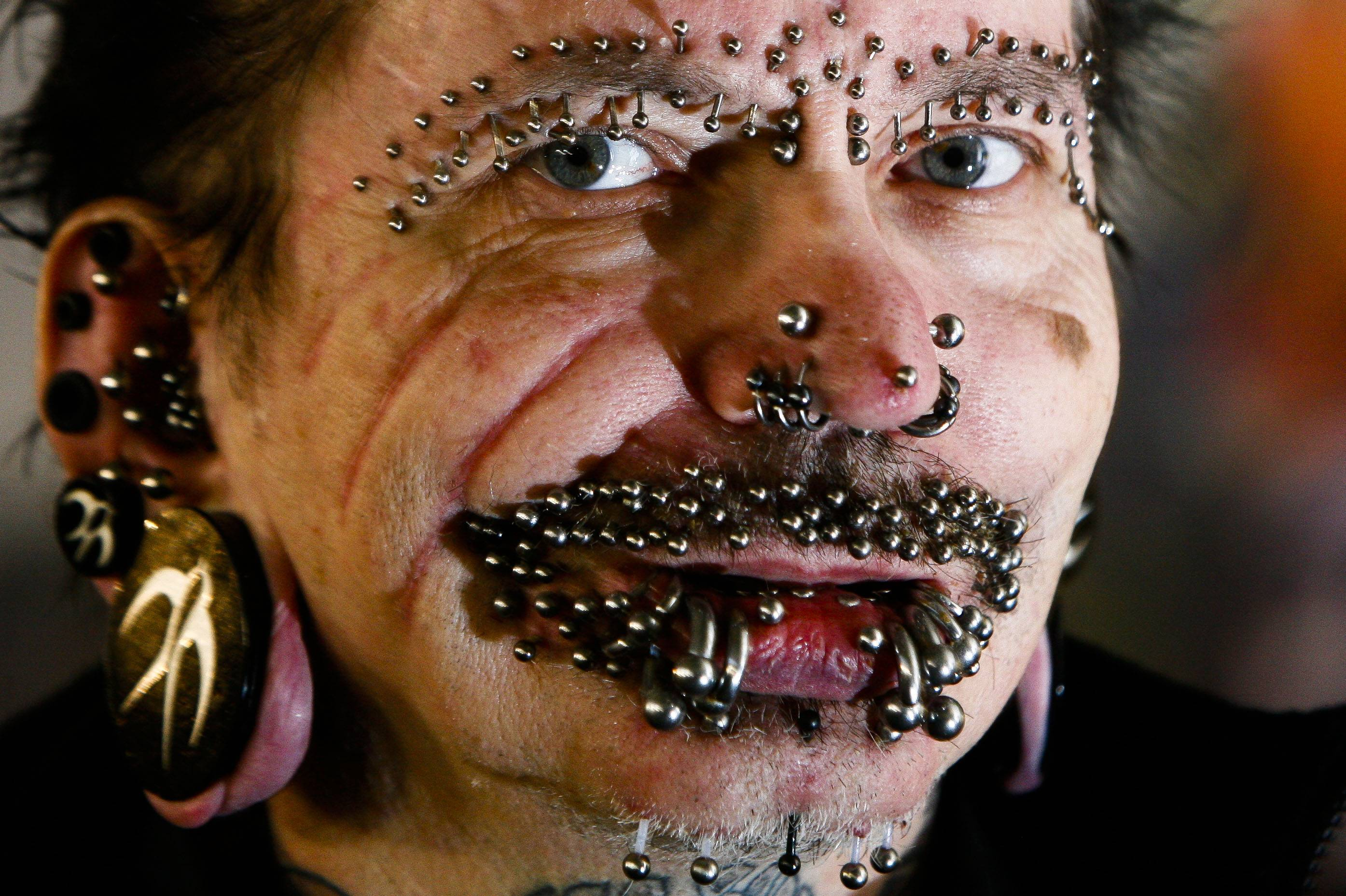 In this Saturday, Dec. 4, 2010 file photo, German Rolf Buchholz shows his face with 168 piercings as he visits the 20th Tattoo Convention in Berlin. A Dubai nightclub that hoped to feature Buchholz, who holds the world record for having the most piercings, said in an emailed statement Sunday, that he was refused entry to the Gulf city because of security concerns. The German man now has 453 piercings, according to Guinness World Records.