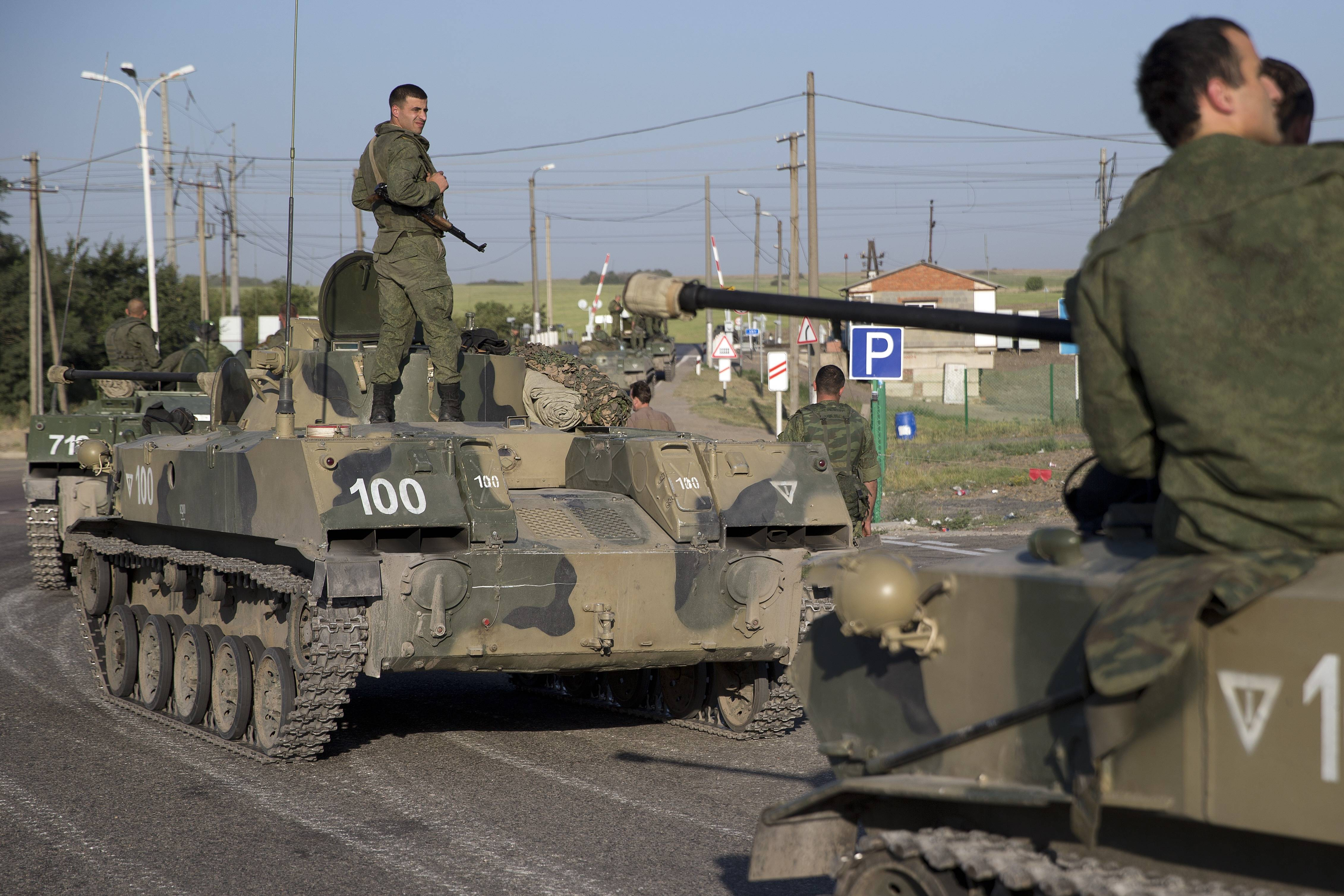 Russian solders with their several military vehicle gather at the rail road crossing early Friday about 19 miles from Ukrainian border at Rostov-on-Don region, Russia.