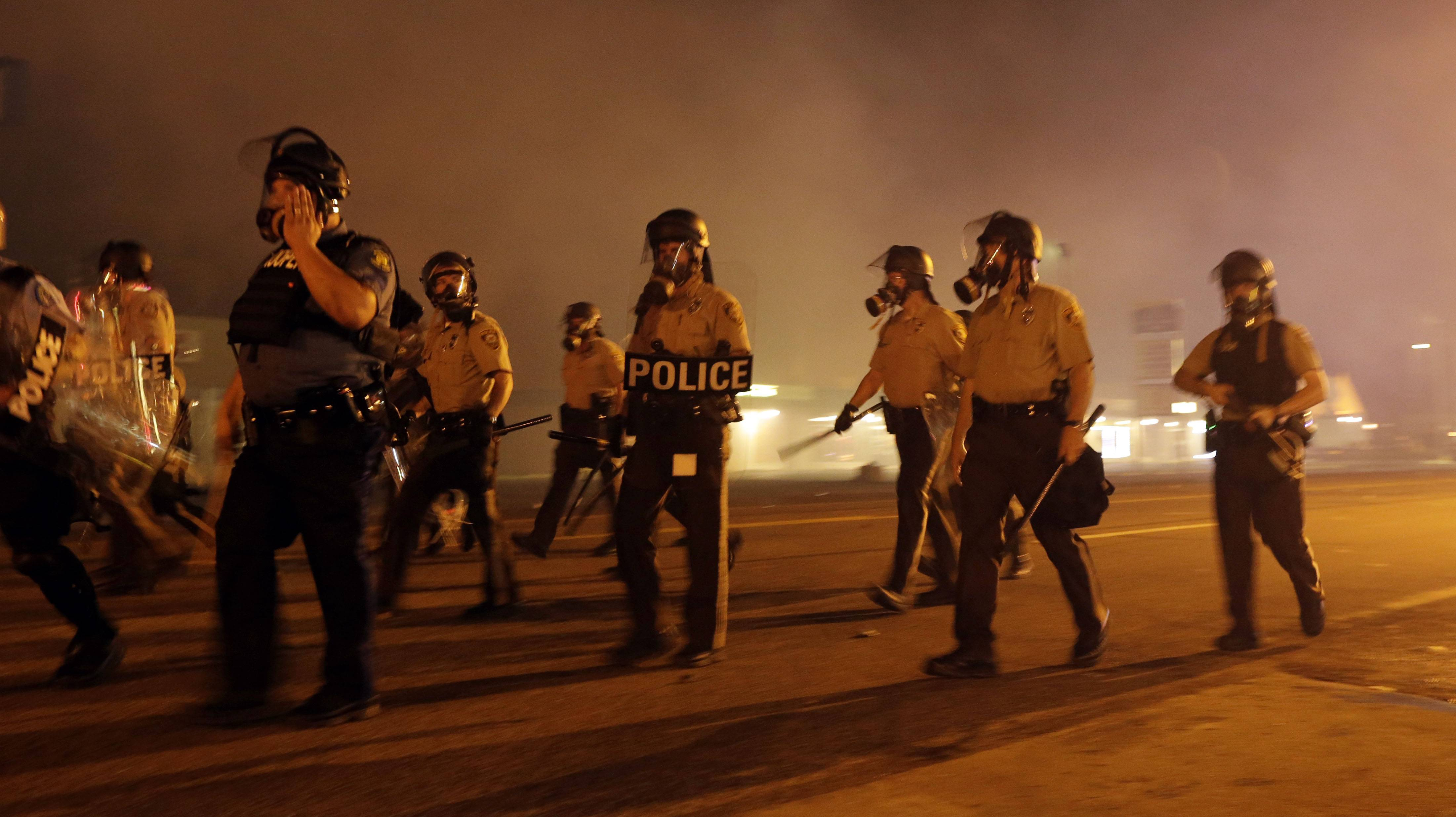 Police, protesters clash ahead of Ferguson curfew