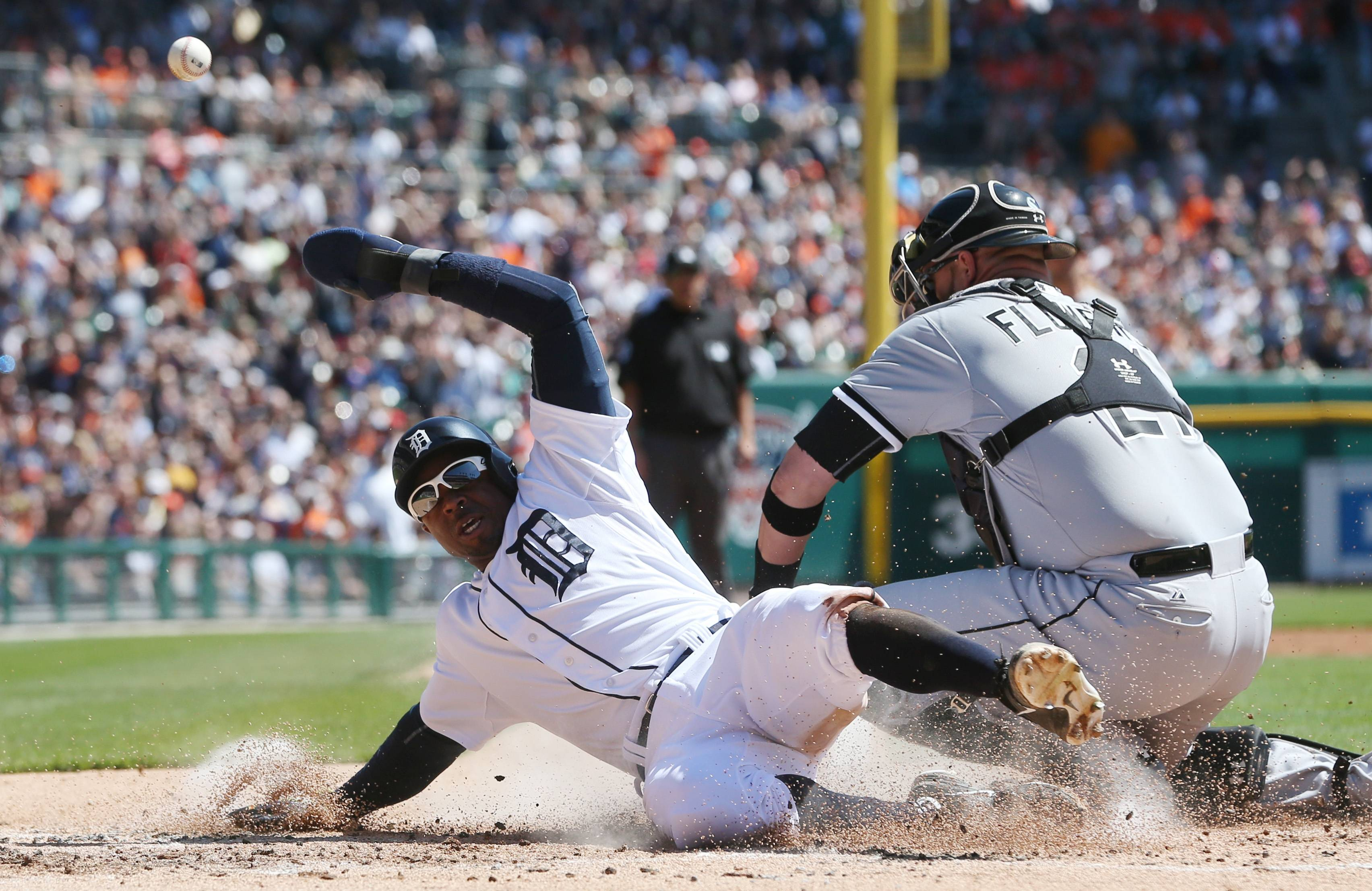 White Sox catcher Tyler Flowers misplays the throw from center fielder Adam Eaton to allow Detroit Tigers' Rajai Davis to score from third on Saturday,
