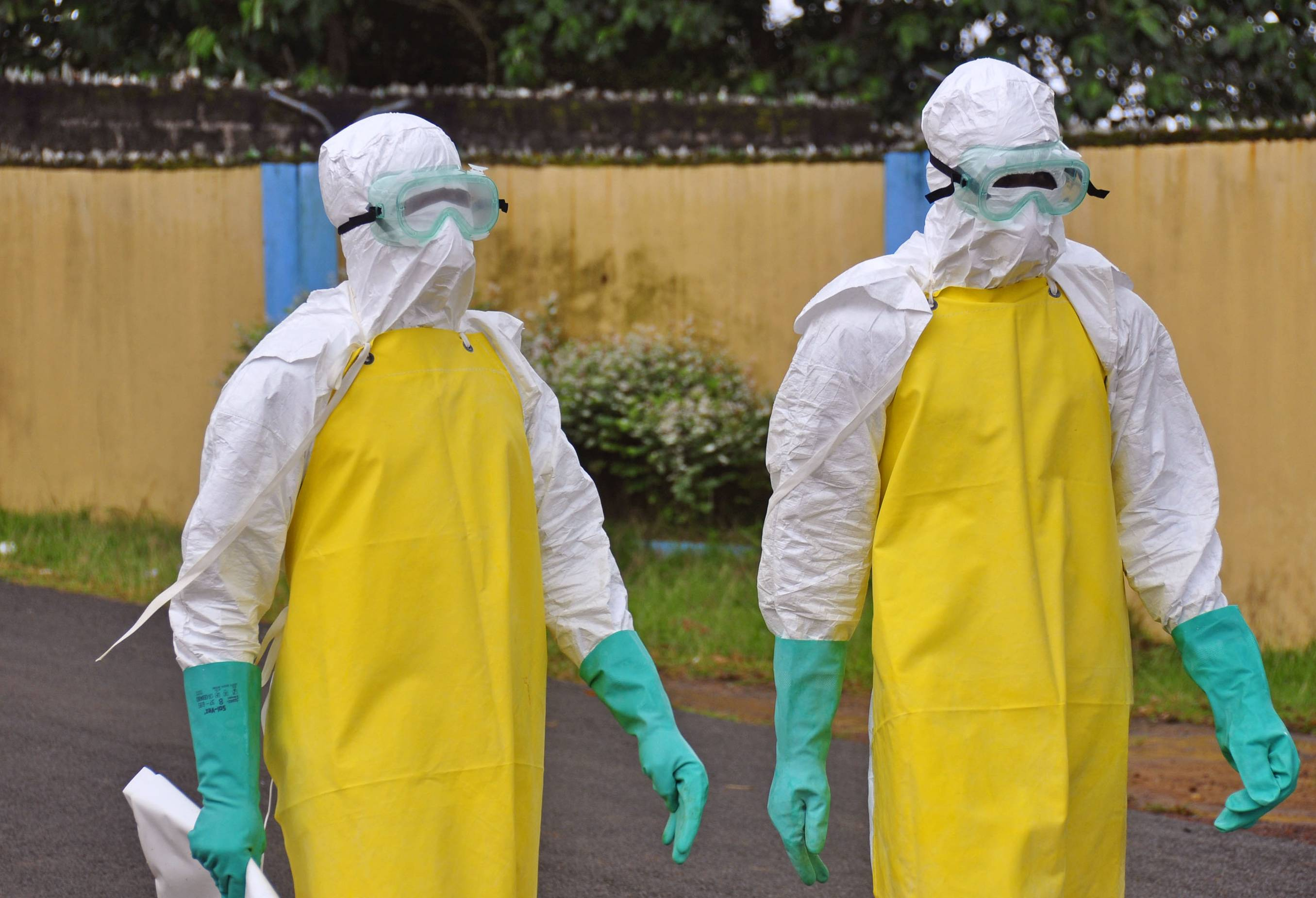 Health workers wearing protective gear Saturday go to remove the body of a person who is believed to have died after contracting the Ebola virus in the city of Monrovia, Liberia. New figures released by the World Health Organization showed that Liberia has recorded more Ebola deaths -- 413 -- than any of the other affected countries.