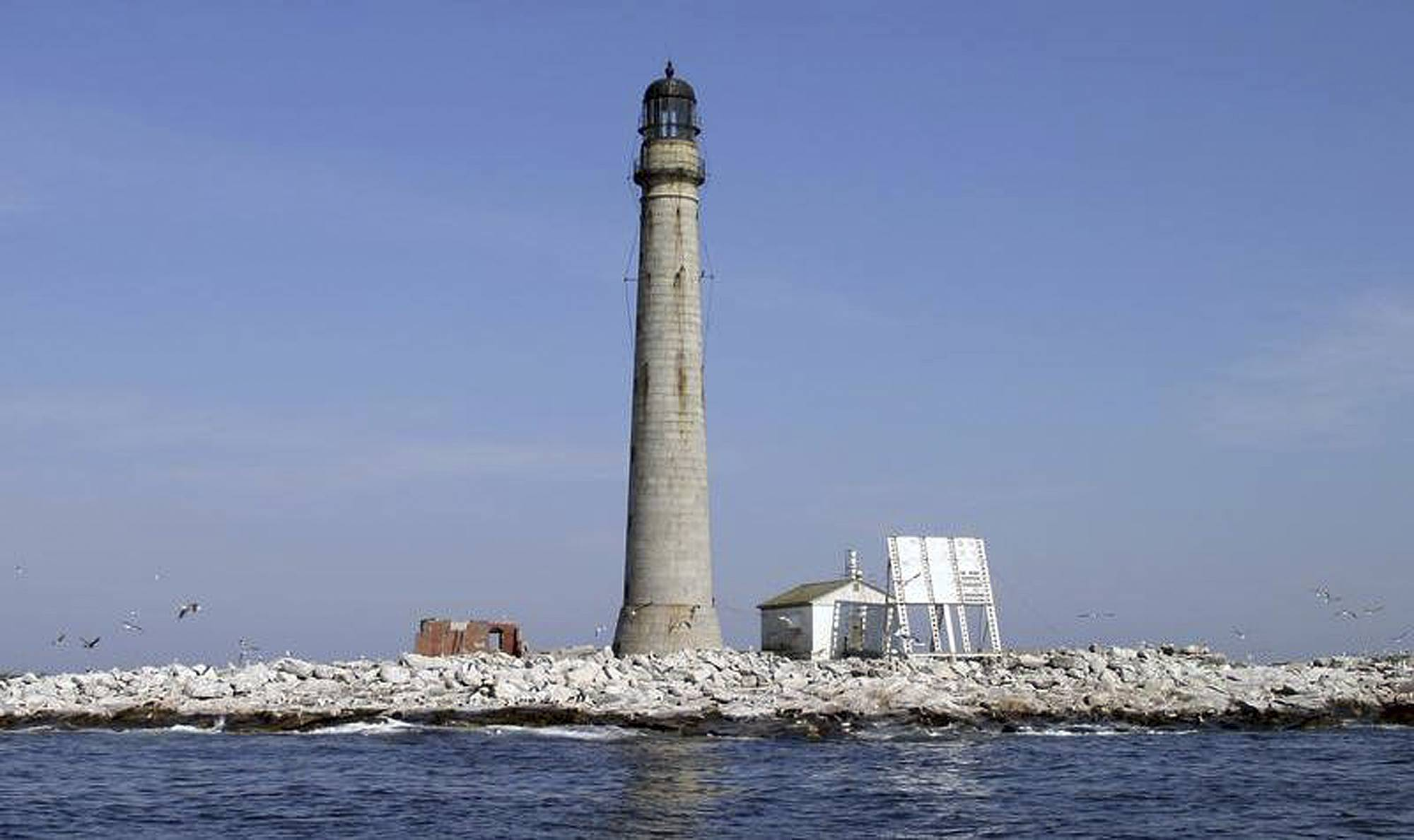 In this undated photo released by the U.S. General Services Administration, Boon Island Light Station sits in the Gulf of Maine about six miles off the coast of York, Maine. The lighthouse, New England's tallest at 133-feet, was up for auction.