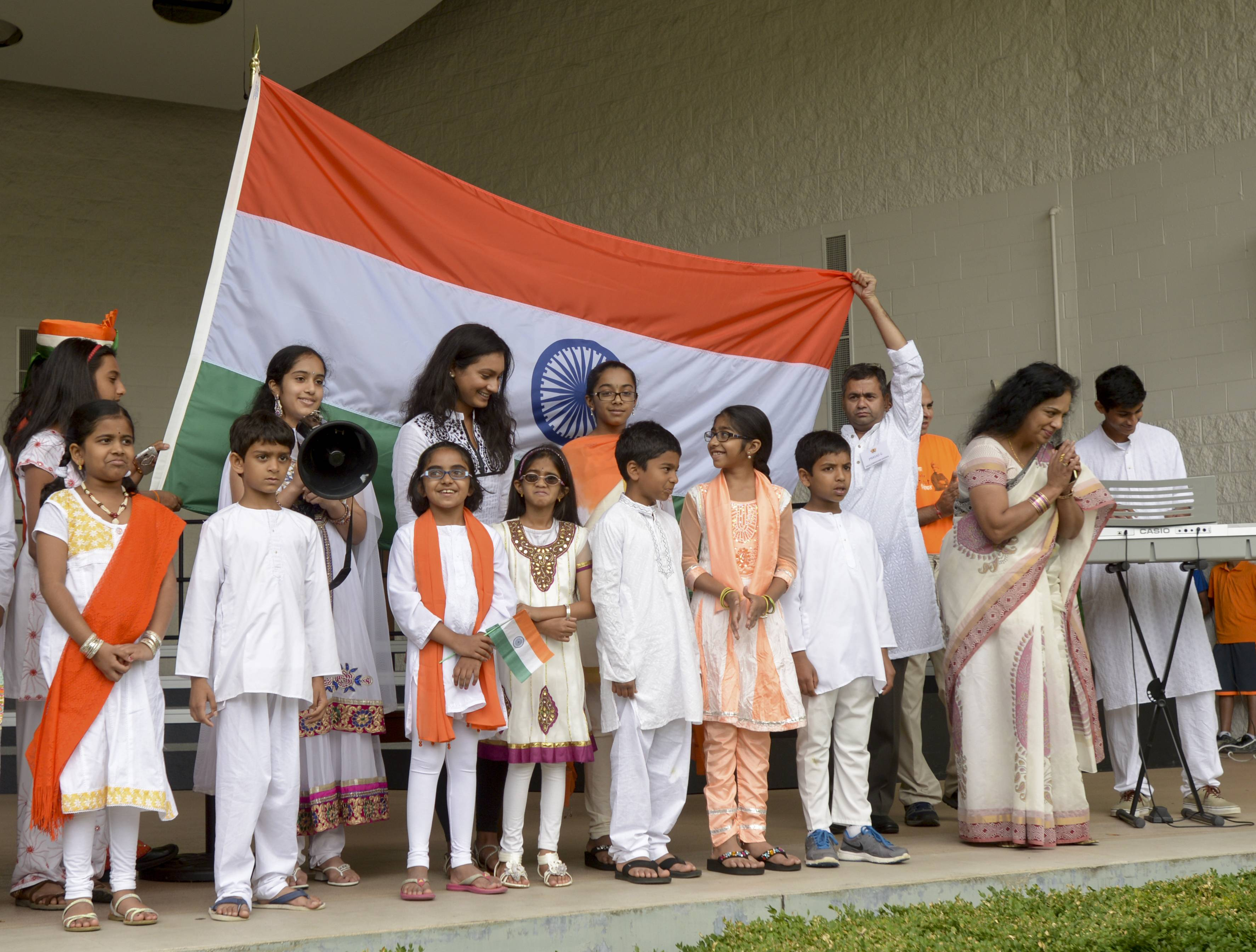 Members of the suburban Indian Community sang the Indian national anthem on Sunday to kick off the Indian Independence celebration at Central Park in Naperville.
