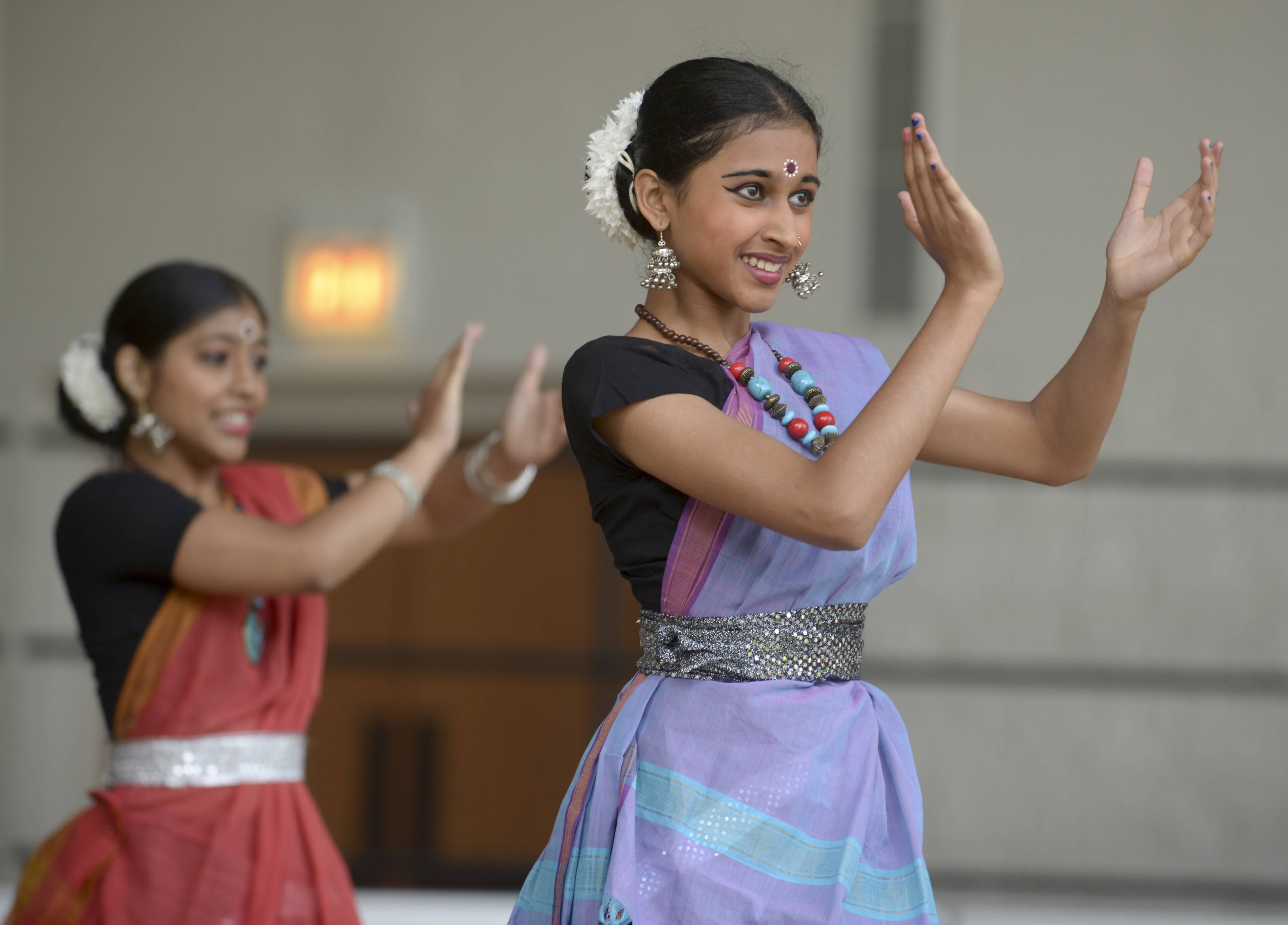 Adithi Arunkumar of Bolingbrook performs with fellow members of the Nrithyanjali School of Dance during the Naperville Indian Community Outreach's Indian Independence celebration Sunday at Central Park.
