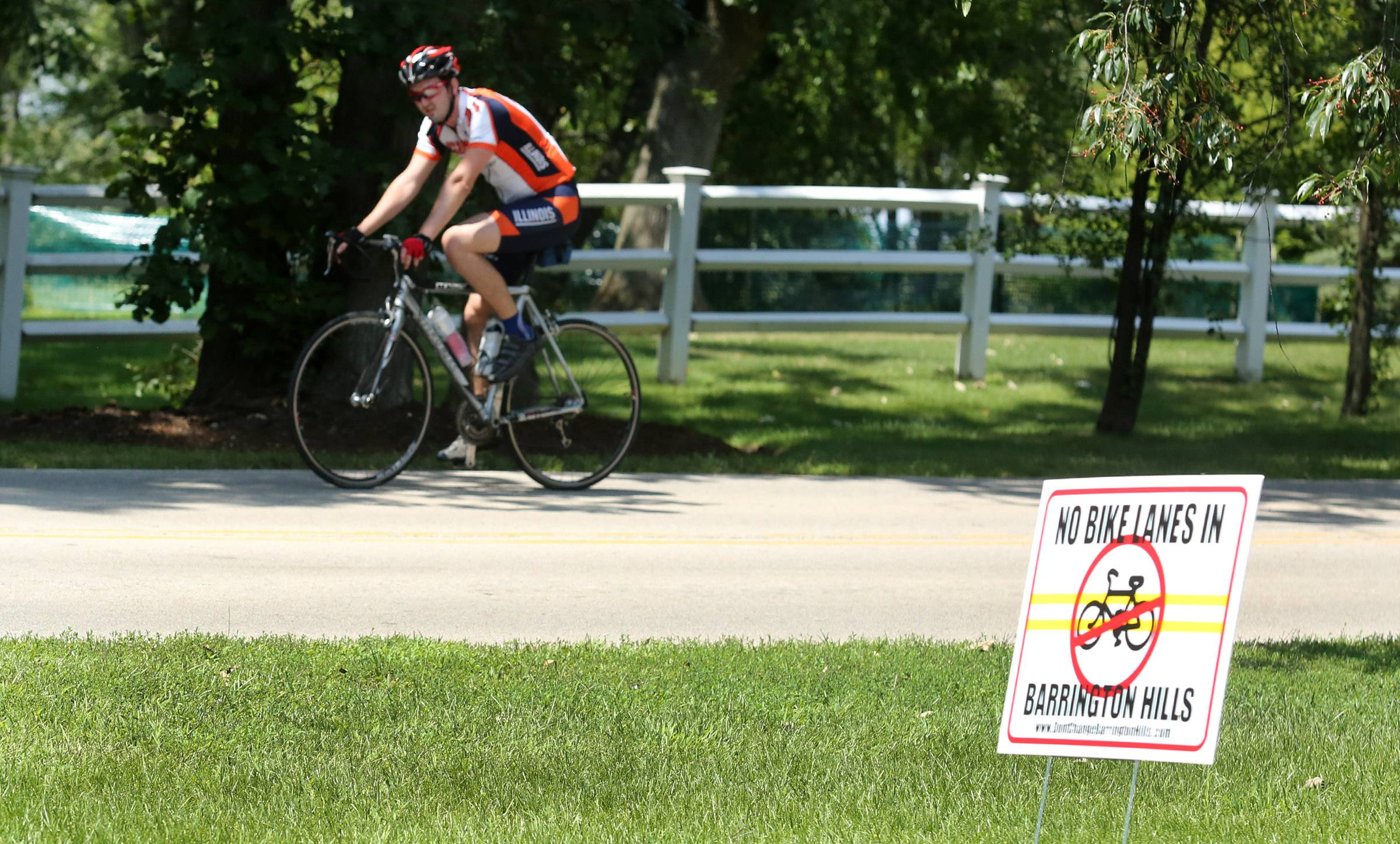 Unlike many suburbs, Barrington Hills is not welcoming to cyclists who ride along the village's scenic roads. Cyclists say residents have yelled at them, driven them off the road and even pelted them with objects.