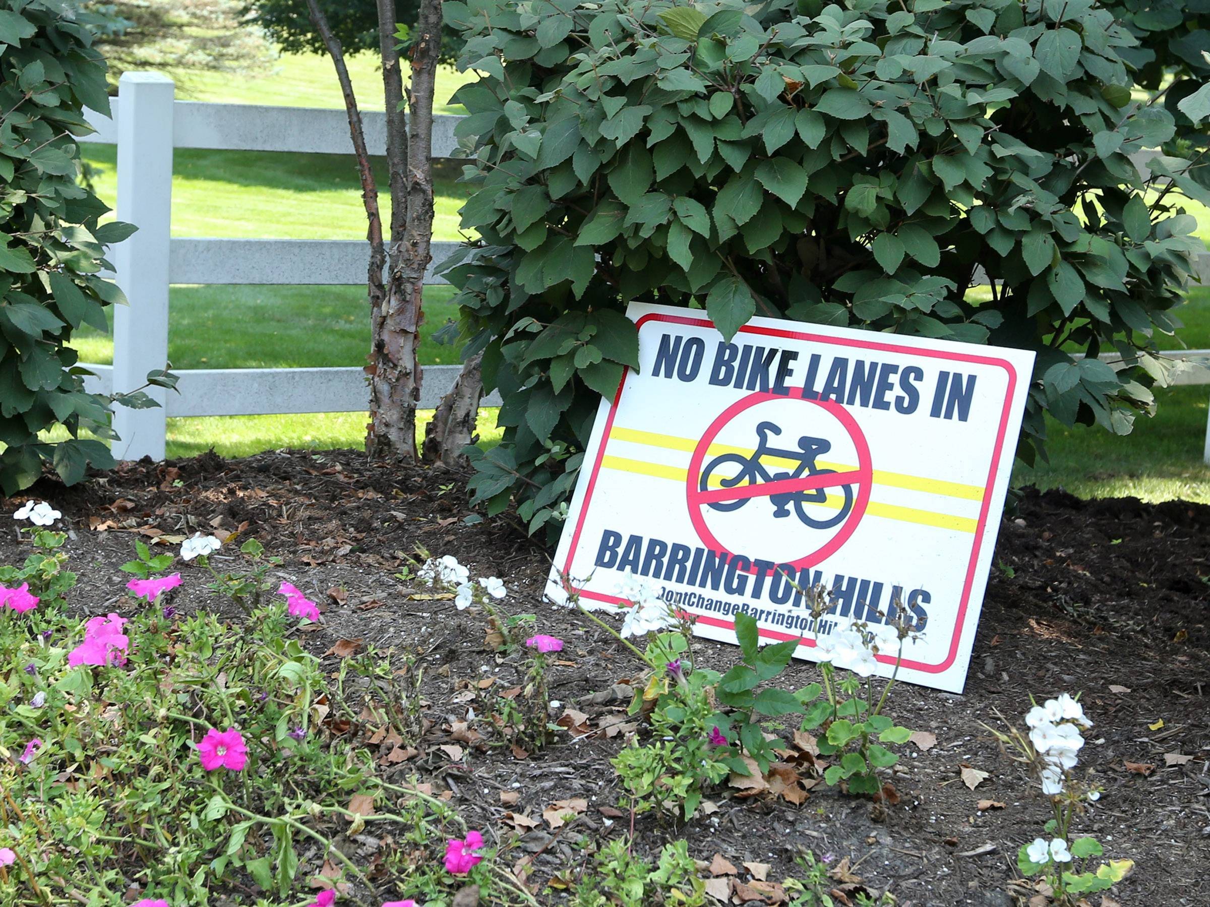 Yard signs popped up in Barrington Hills this summer after reports surfaced that the officials would consider adding bike lanes along a scenic village road.