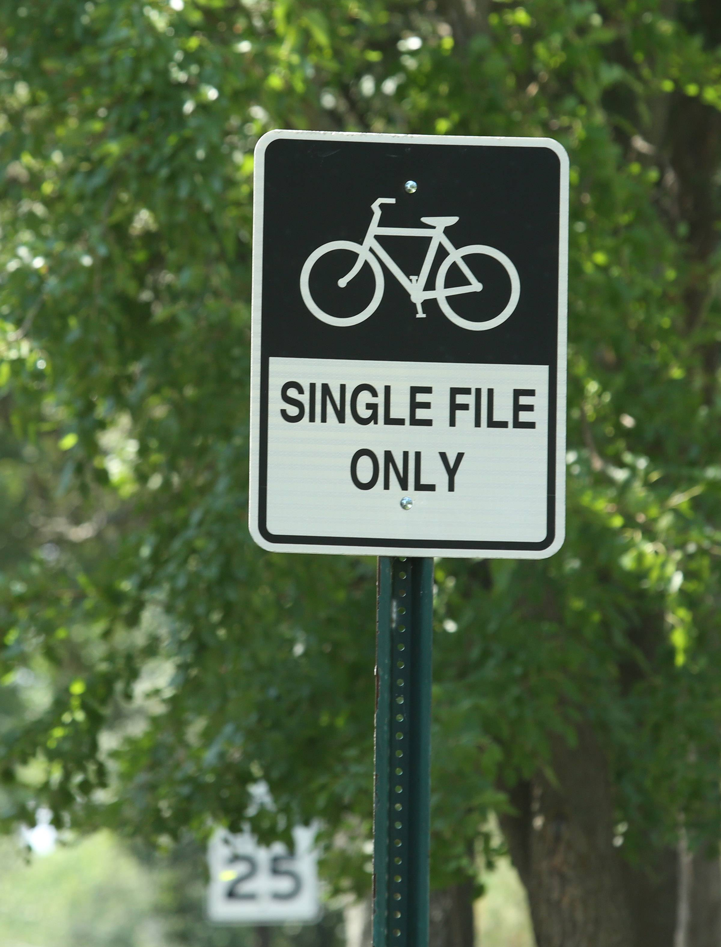 Despite signs informing cyclists to ride in single file, Barrington Hills residents say bikers often flout the rules and block vehicles.