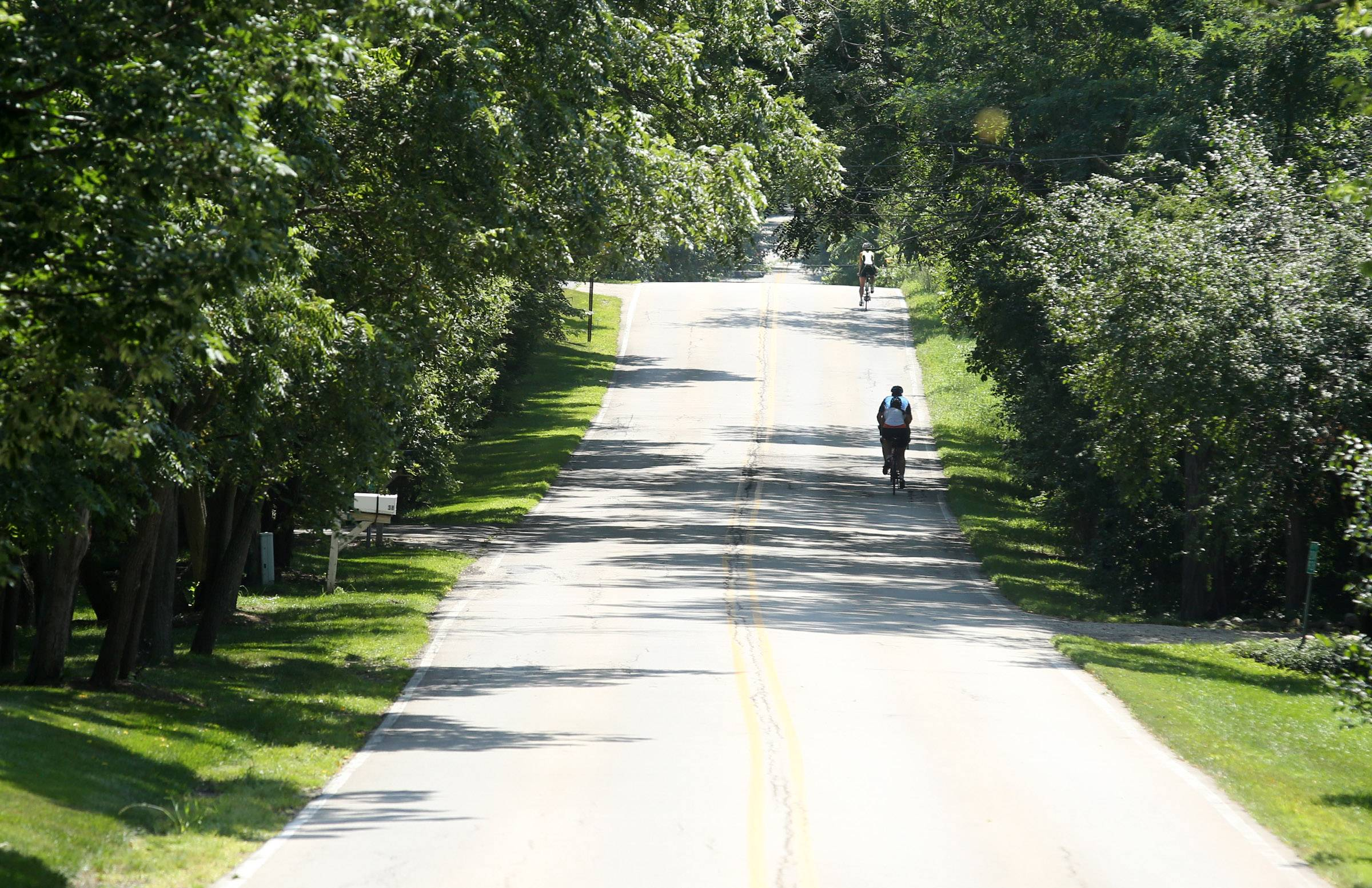 Barrington Hills' quiet, scenic roadways are popular among the town's residents and cyclists passing through, sparking confrontations between the two groups.