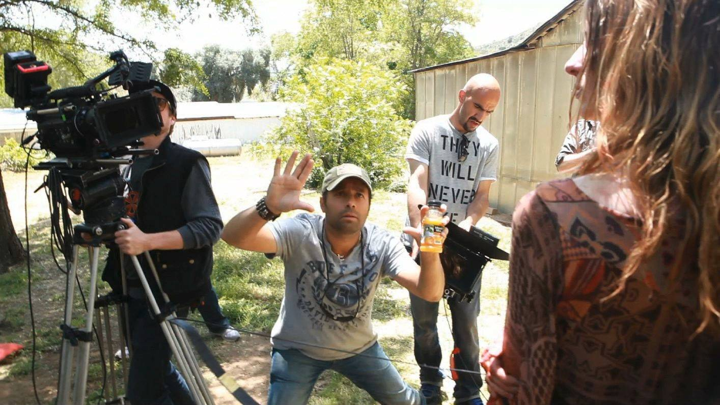 "Des Plaines native Michael S. Ojeda, center, directs a scene from his new horror film ""Savaged."""