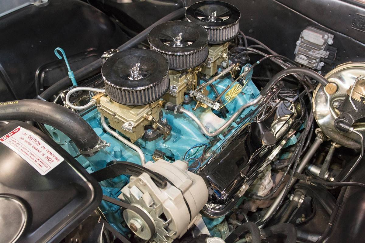Minarich's 1965 GTO features a triple carburetor setup.