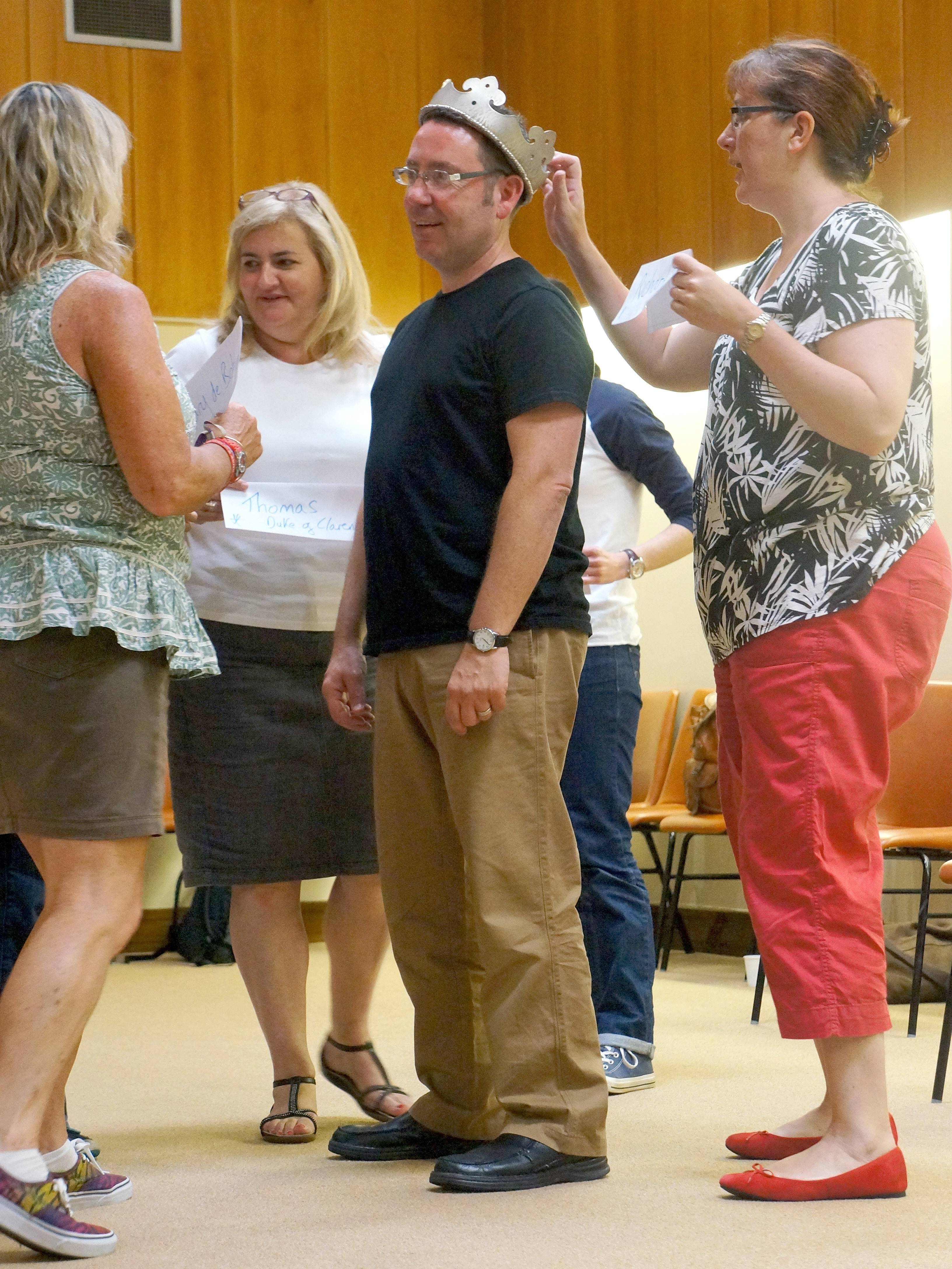 "Sean Hargadon of Elgin, founder of Janus Theater Company, center, wears a crown during a ""What Makes a King?"" exercise at the Teaching Shakespeare workshop held in Stratford-upon-Avon, England."