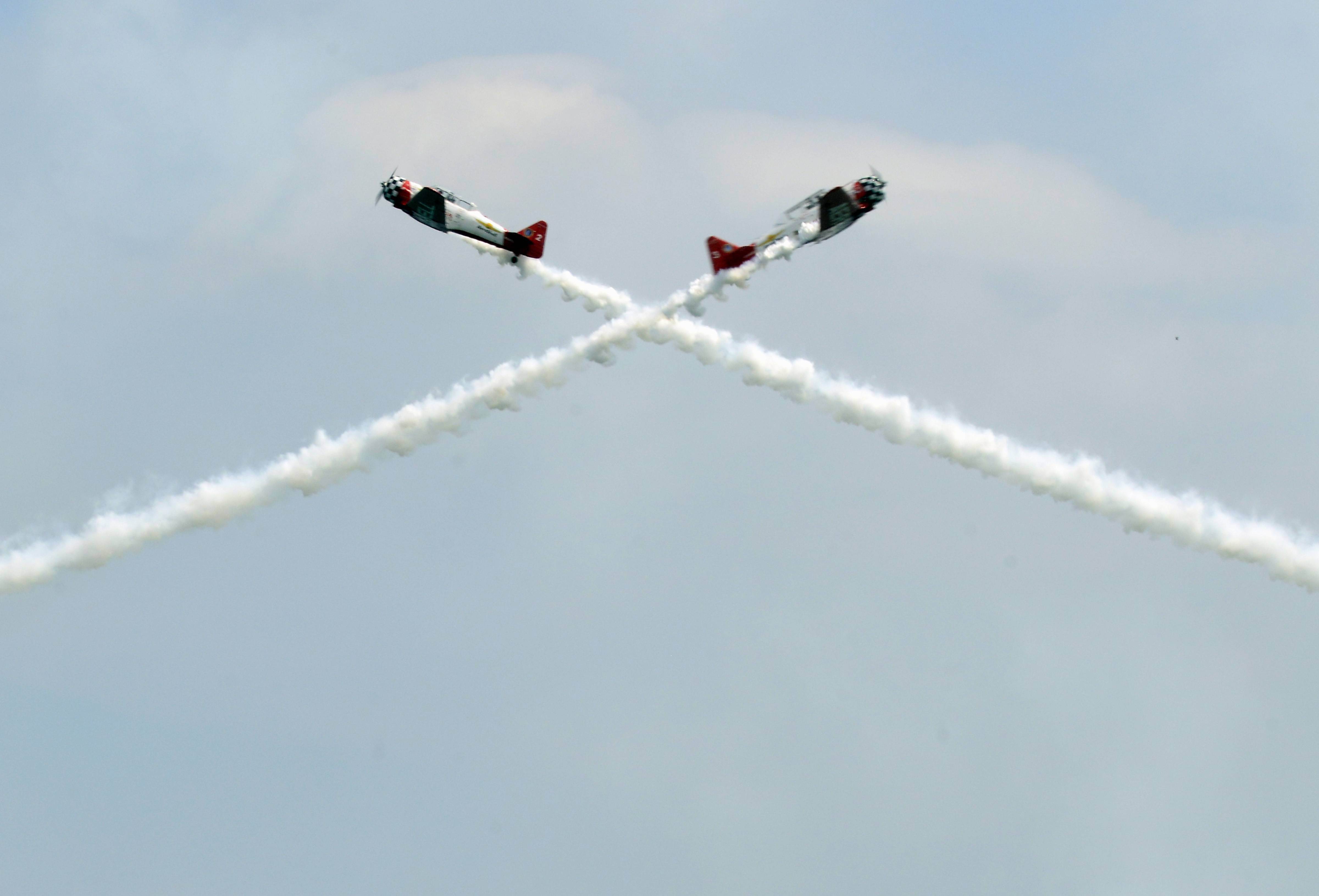 Members of the AeroShell Aerobatic Team perform at the Chicago Air and Water Show Saturday. Officials canceled the show Sunday because of poor visibility.