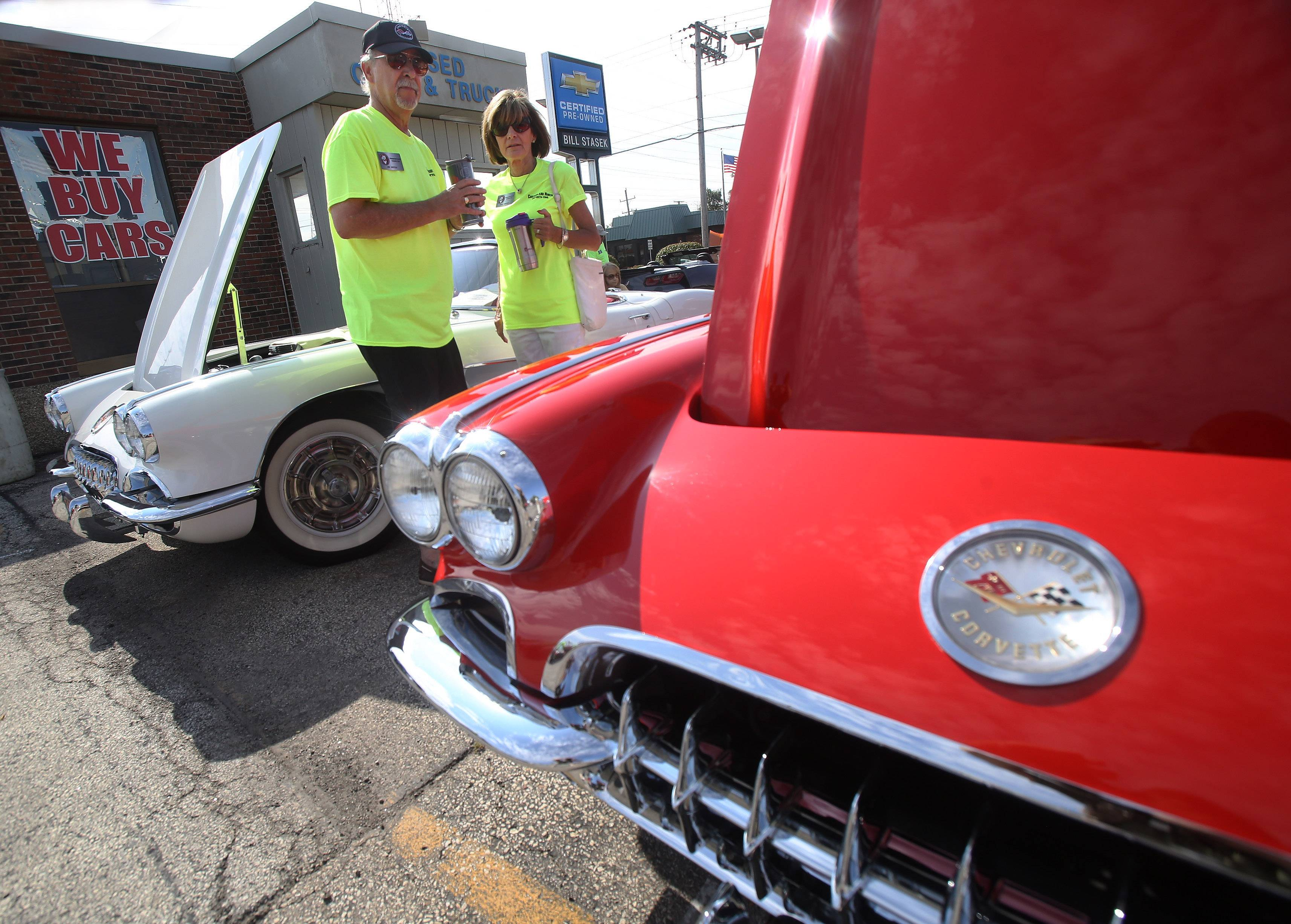 Jim and Peg Kritek, of Northbrook, look at two 1960 Corvette Roadsters during the 9th Annual All-Corvette Show at Bill Stasek Chrevolet in Wheeling. The show was sponsored by the Chicagoland North Corvette Club and featured over 100 Corvettes.