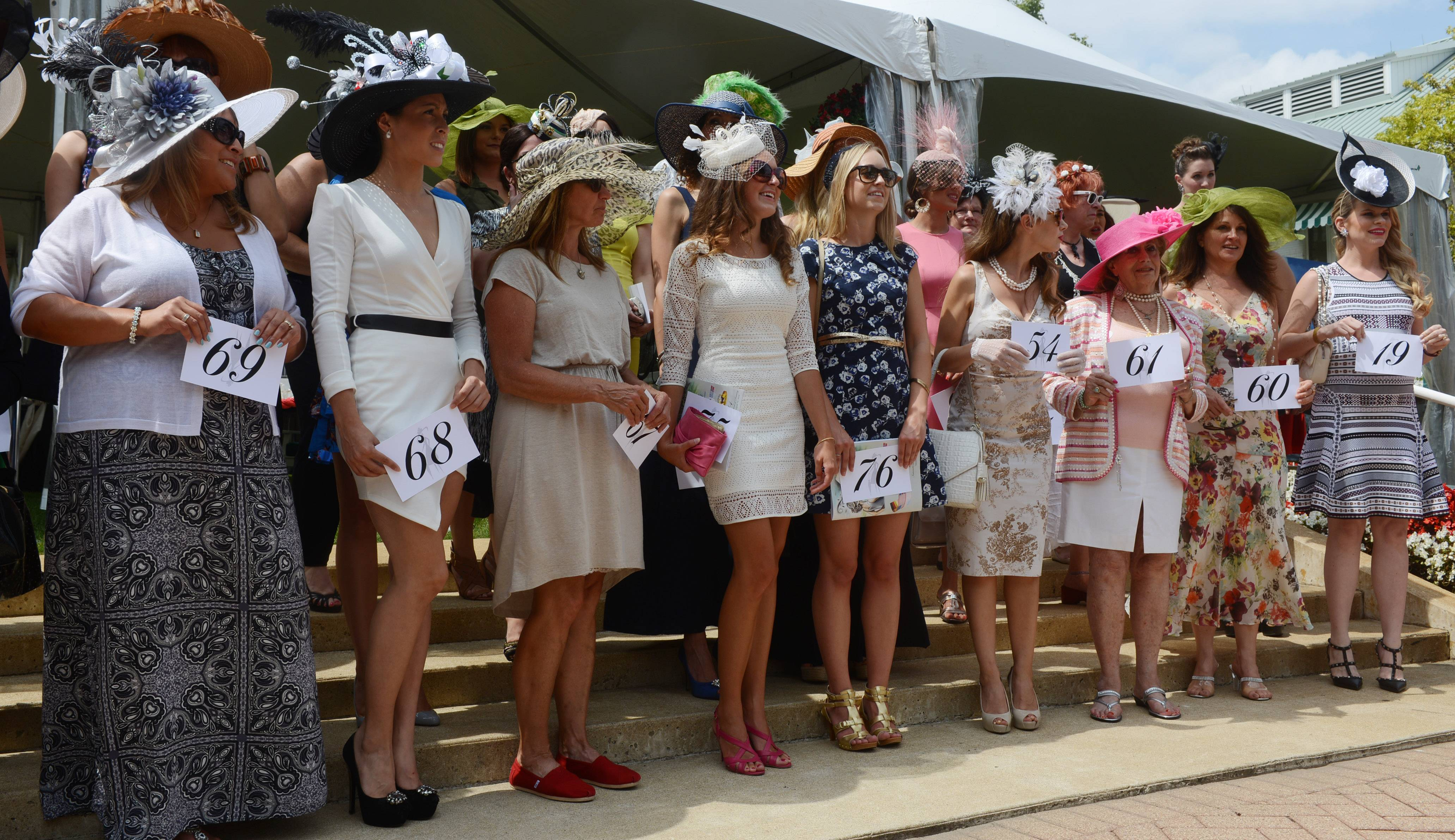 "Participants in the ""Best Dressed Lady"" contest stand together during the International Festival of Racing at Arlington International Racecourse Saturday."