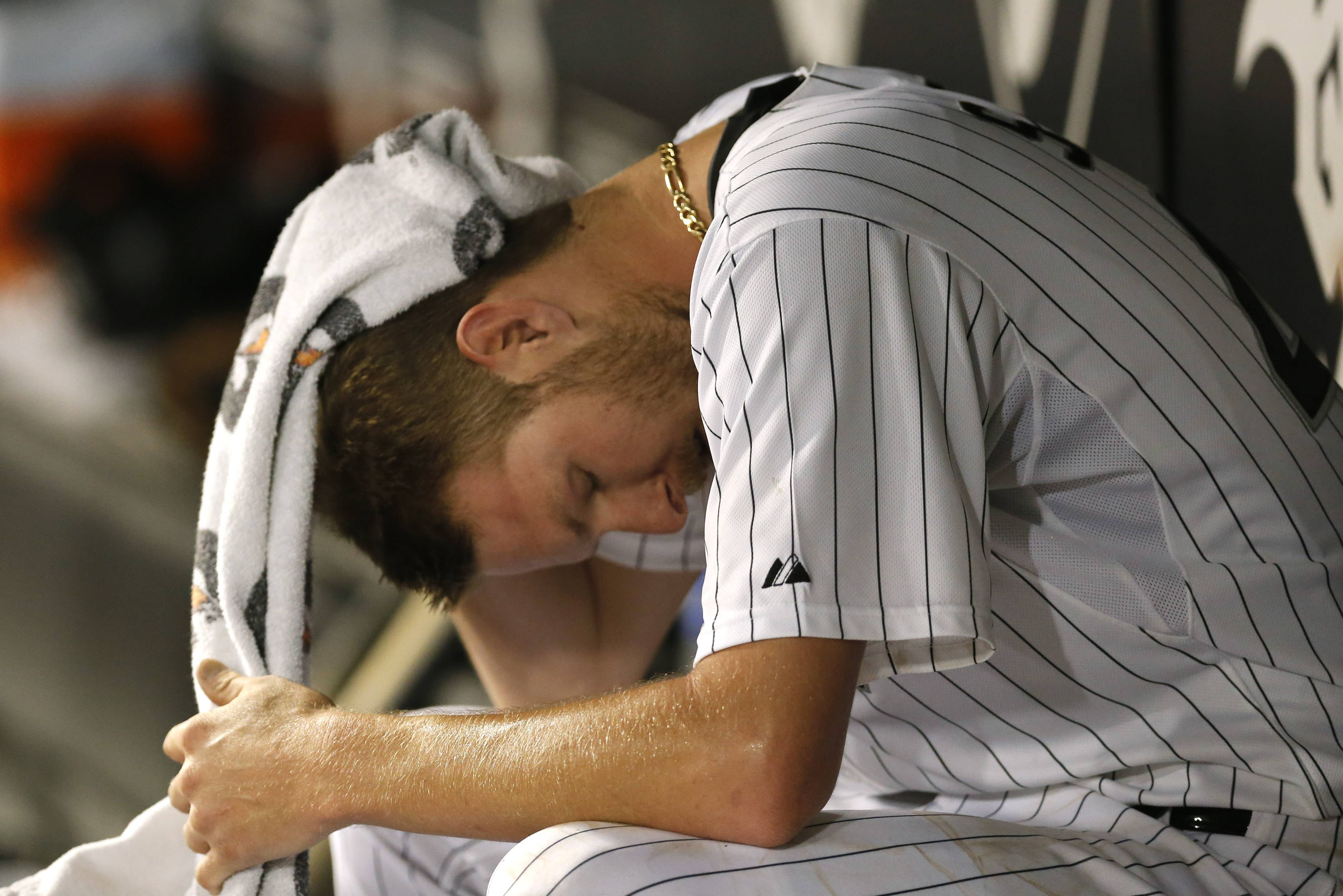 White Sox starting pitcher Chris Sale sits in the dugout after his night was over. Sale worked 6 innings, allowing 3 runs, and suffered the loss to fall to 10-3.