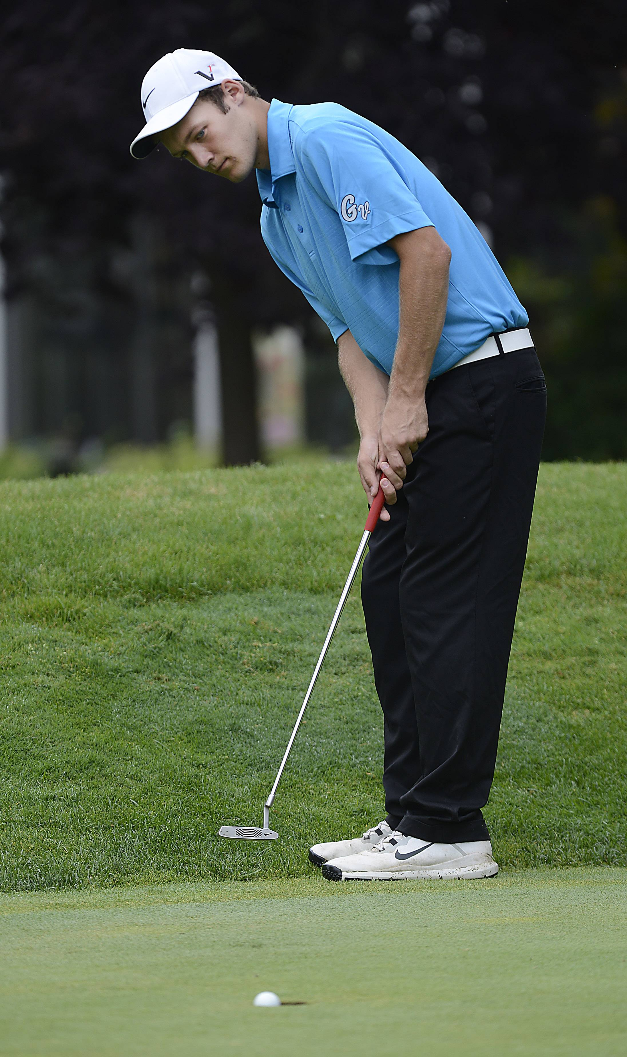 Geneva's Spencer Sharp sees his putt drop Monday during the McChesney Cup at the Geneva Golf Club in Geneva.