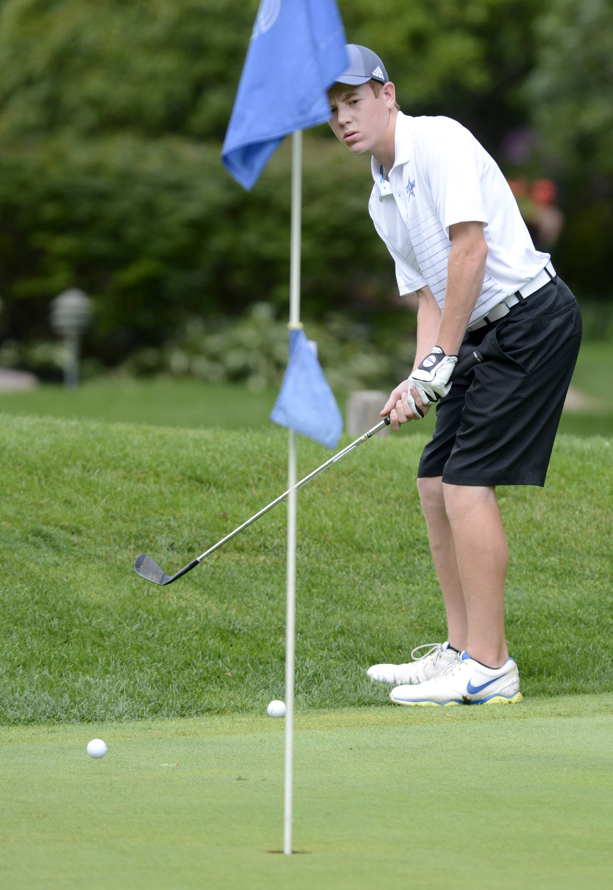 St. Charles North's Liam Smith putts Monday during the McChesney Cup at the Geneva Golf Club in Geneva.