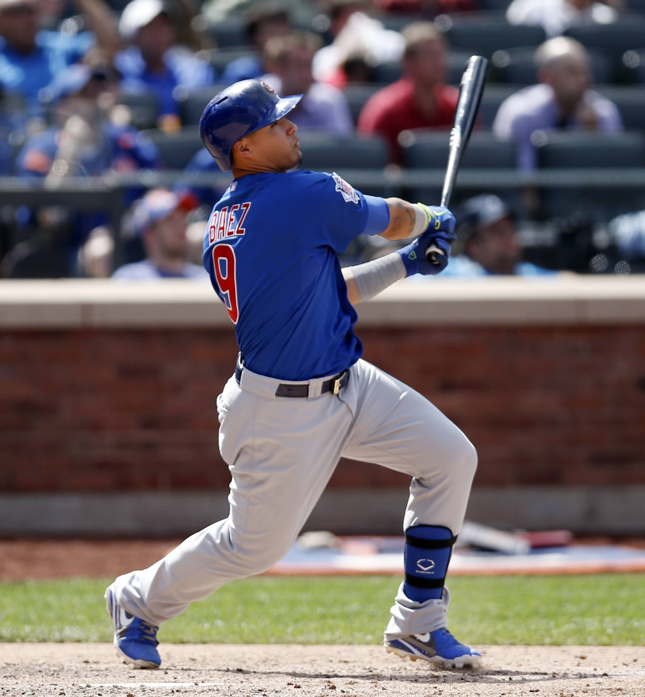 Cubs second baseman Javier Baez hits a two-run home run off New York Mets relief pitcher Jenrry Mejia Monday during the ninth inning at Citi Field in New York.