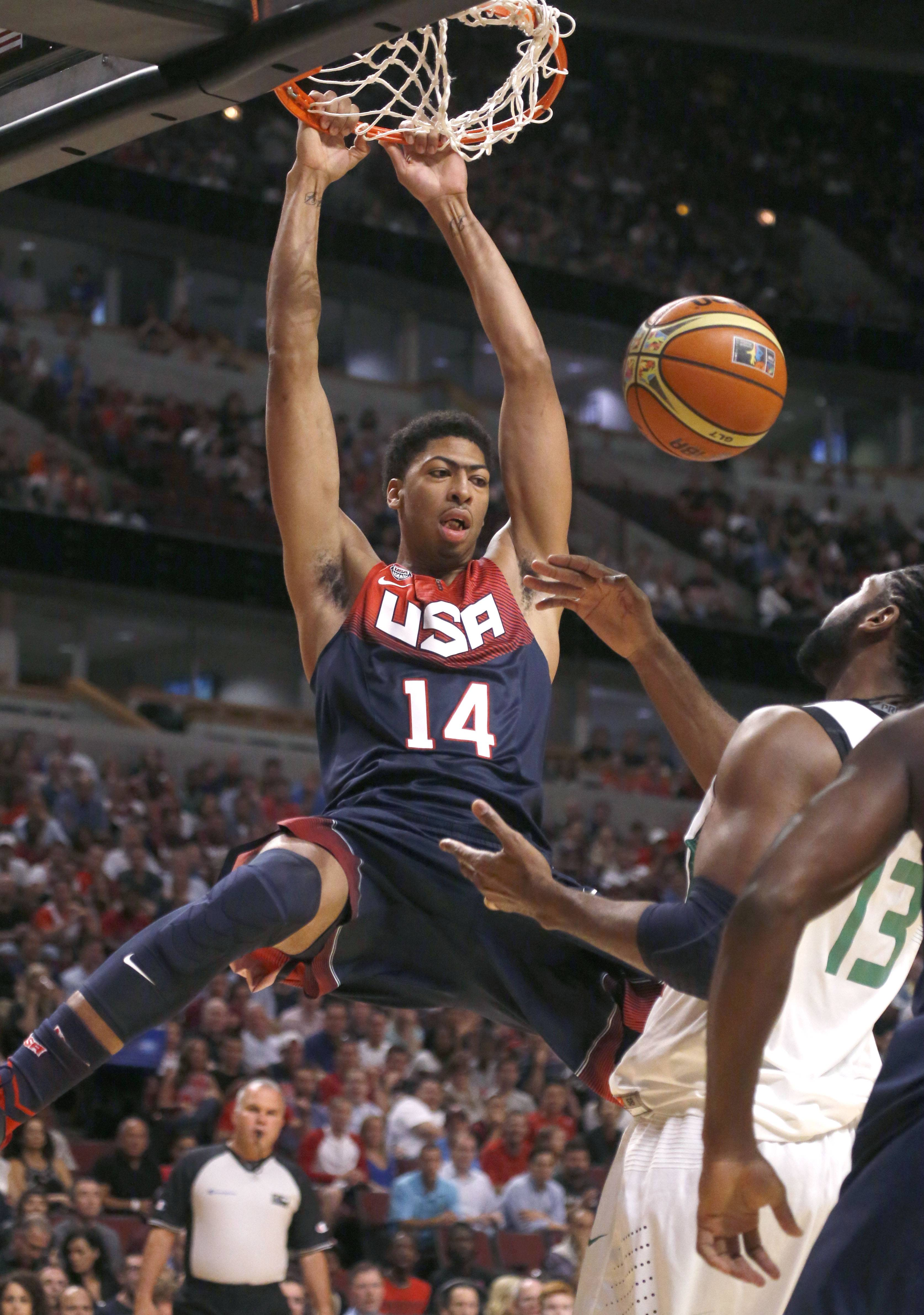 United States' Anthony Davis dunks over Brazil's Nene Hilario during Saturday's exhibition game at the United Center. Davis finished with 20 points in the U.S. victory.