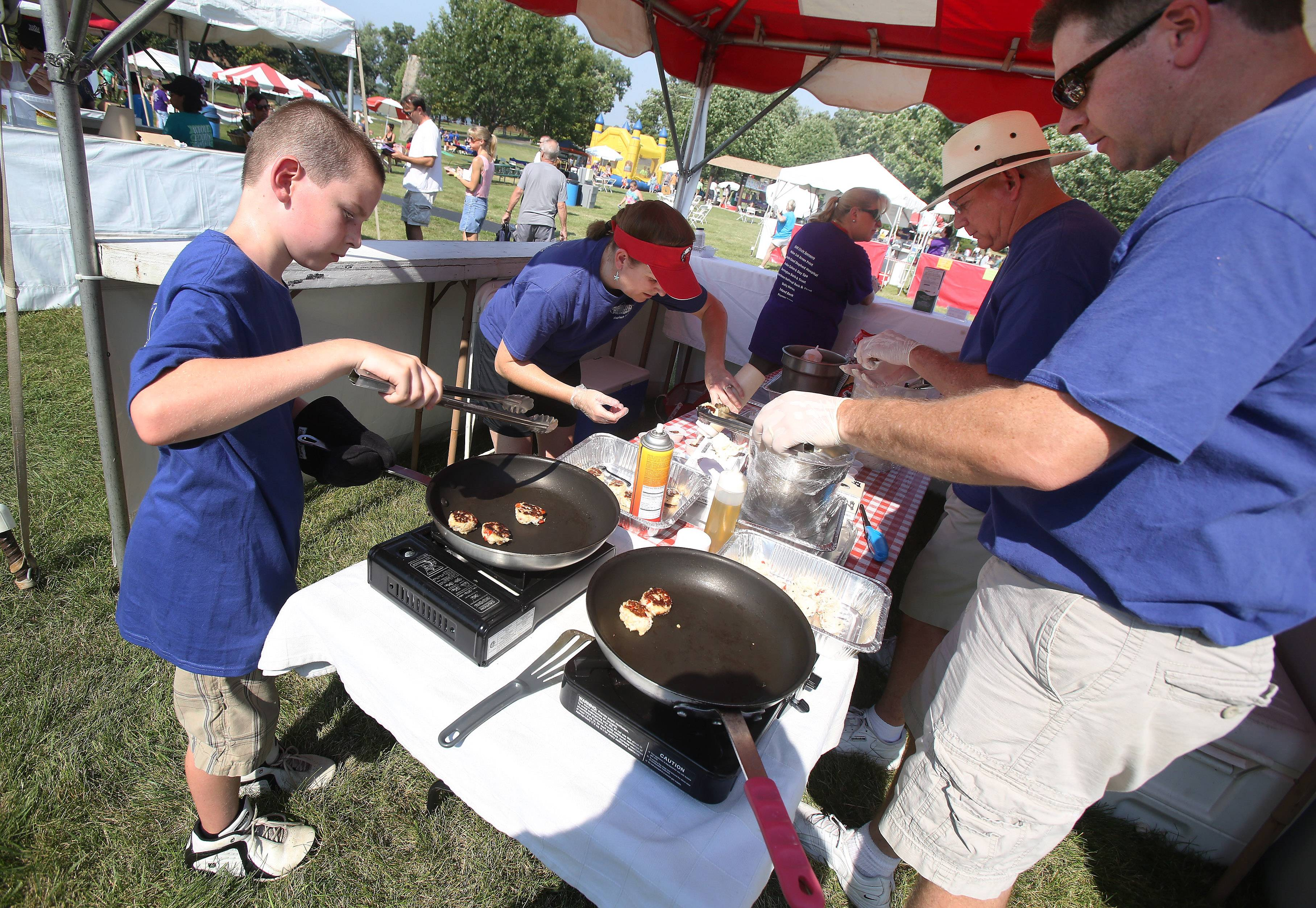 Food is prepared at last year's Lake Zurich Taste of the Towns in Paulus Park. The event includes restaurants, wineries, breweries and grocery stores from around the area.