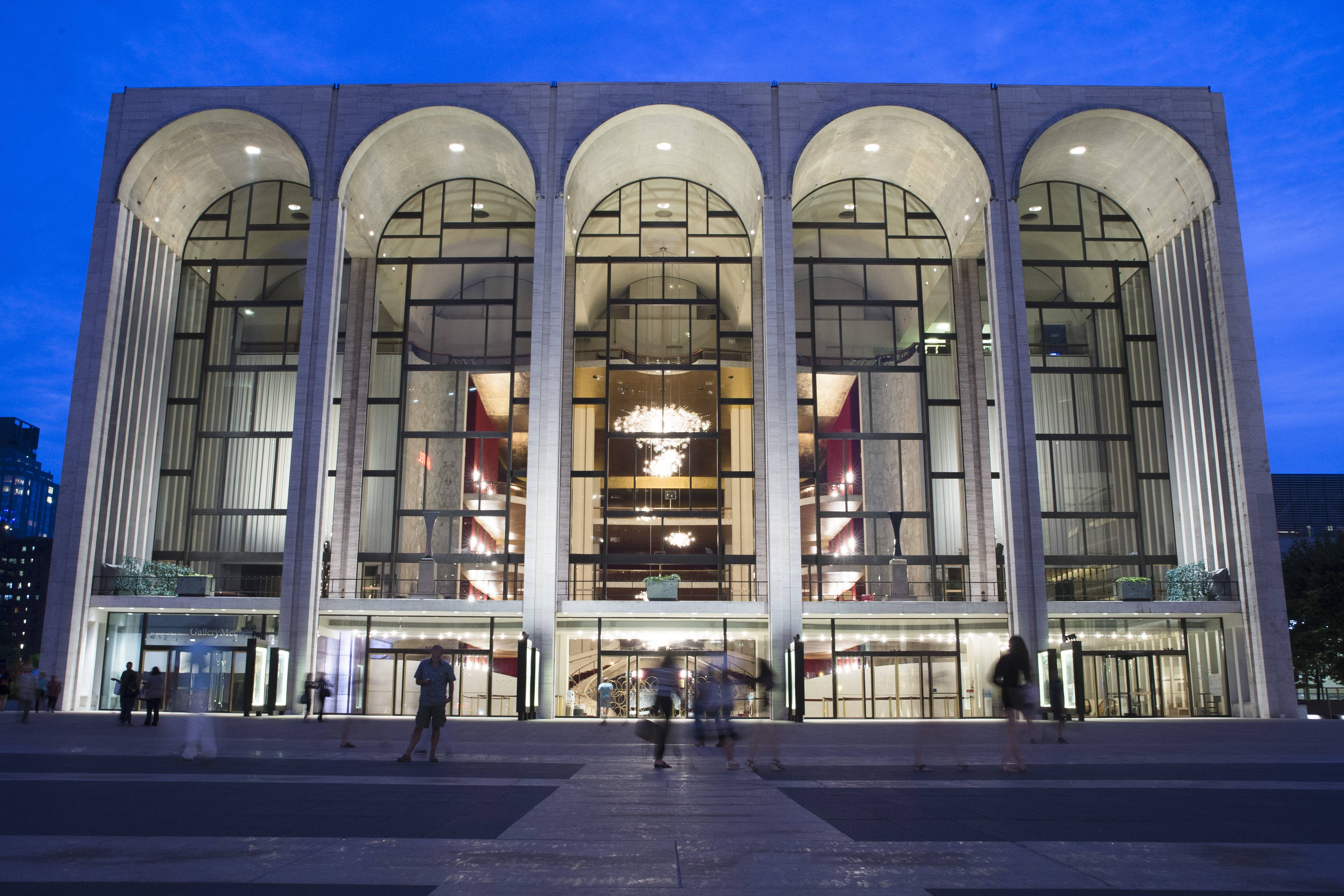 New York's Metropolitan Opera reached tentative labor deals with two of its largest unions early Monday while negotiations continued with 10 more unions in hopes of averting a lockout.
