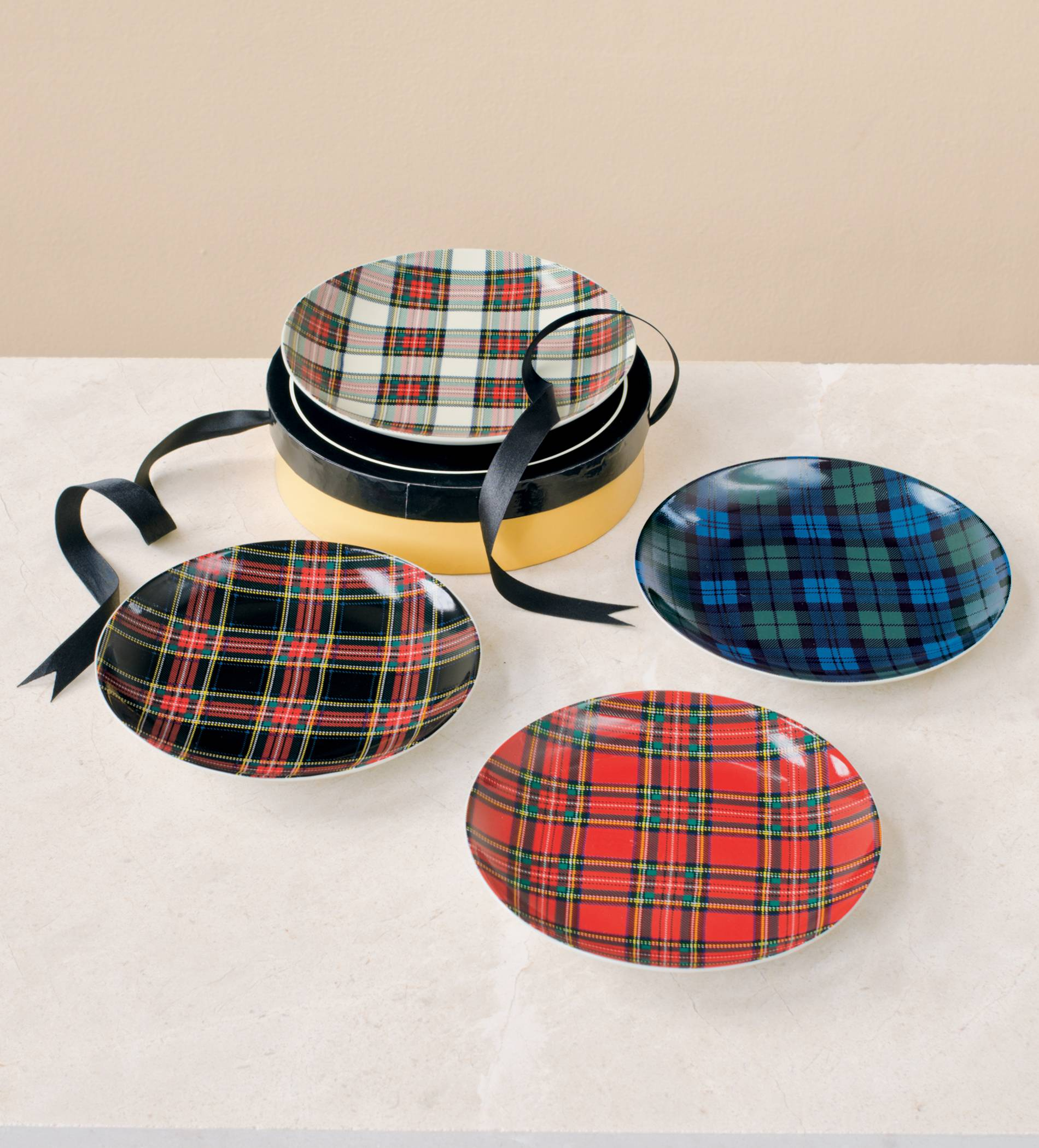 Tartan plates, such as these found at Pendleton-usa.com, take the Scottish décor trend to the table. The iconic pattern is showing up on furnishings and accessories for this fall as Scotland joins England as an inspiration for designers.