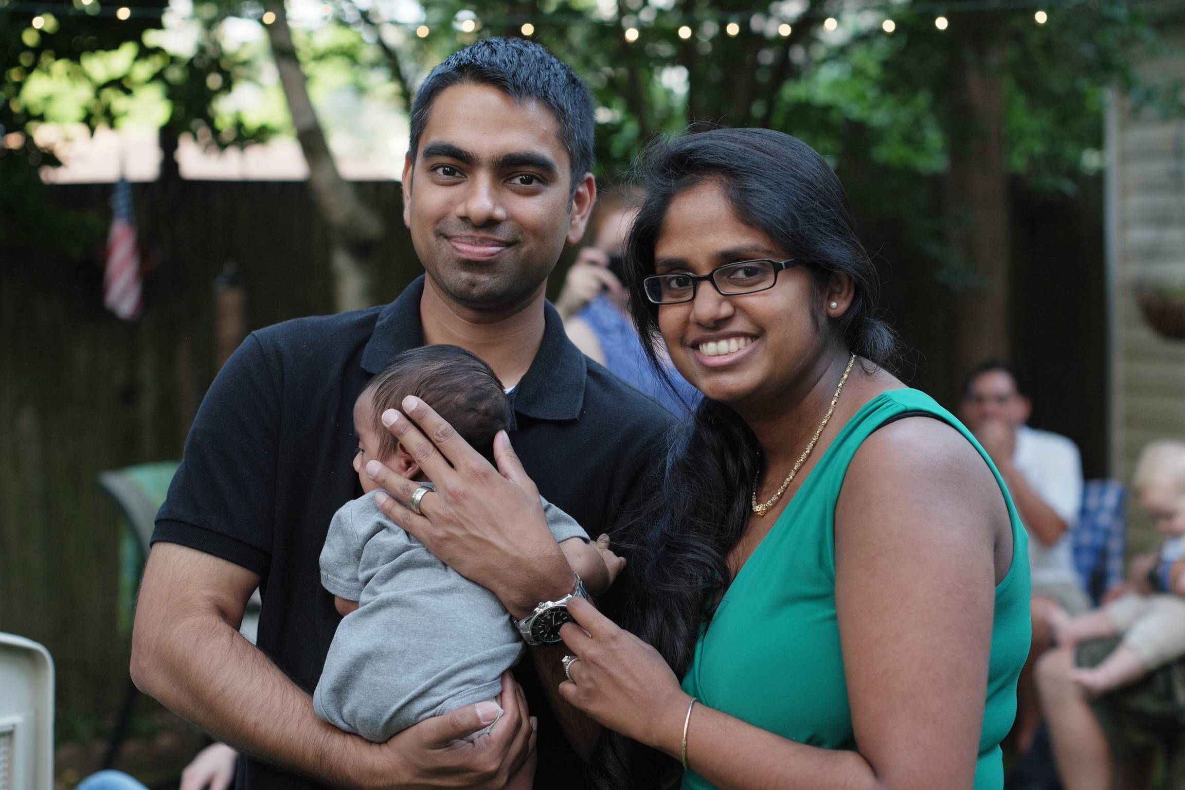 "Wasim Ahmad, left, and his wife, Lakshmi Ramsoondar-Ahmad, pose with their newborn son in Merrick, N.Y. Two days after his son was born, Ahmad bought the website domain with his son's name. ""I'm going to make it a private website with a password so family can log in"" to see updates, he says. ""When he gets old enough, I'll probably give him the keys."""