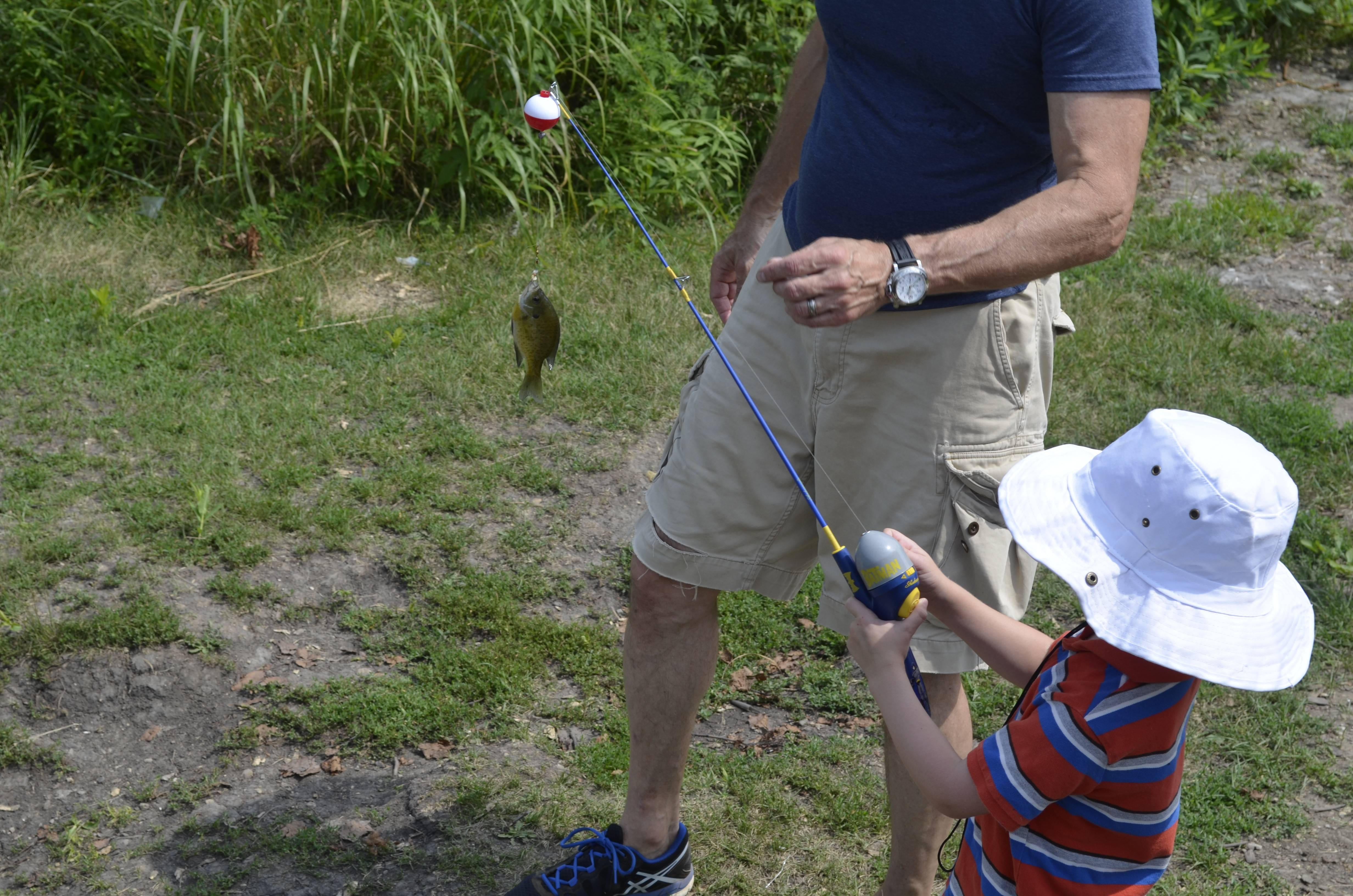 Two dads and two young boys fishing in Naperville's May Watts Park sparked all sorts of fond memories for our Stephanie Penick.