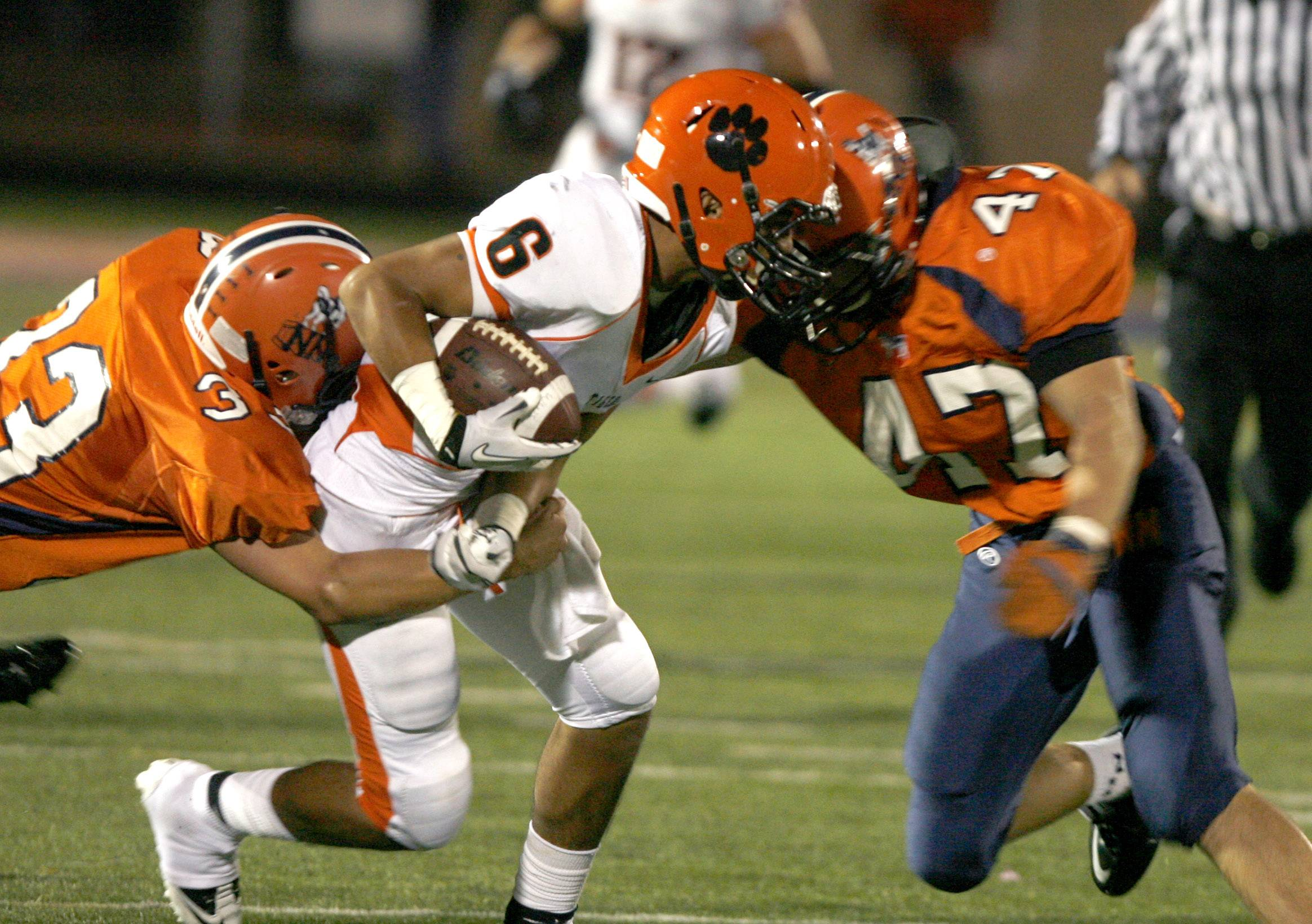 Players from Naperville North and Wheaton Warrenville South high schools clash in a 2011 match.