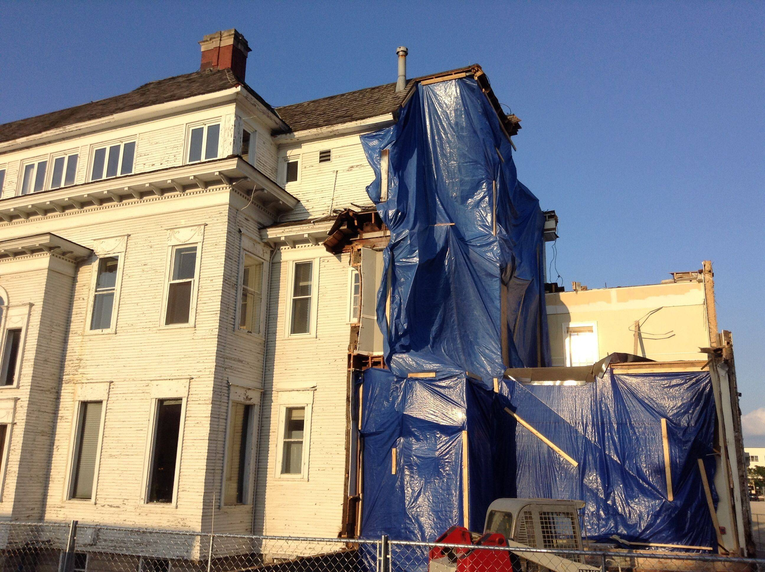 The southwest corner of the Barrington White House, seen here Monday, has undergone great change during the first month of the project to renovate the 116-year-old building.