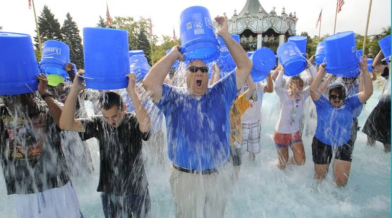 Hank Salemi, park president of Six Flags Great America, and park employees took part in the Ice Bucket Challenge on Monday to benefit the fight against ALS.