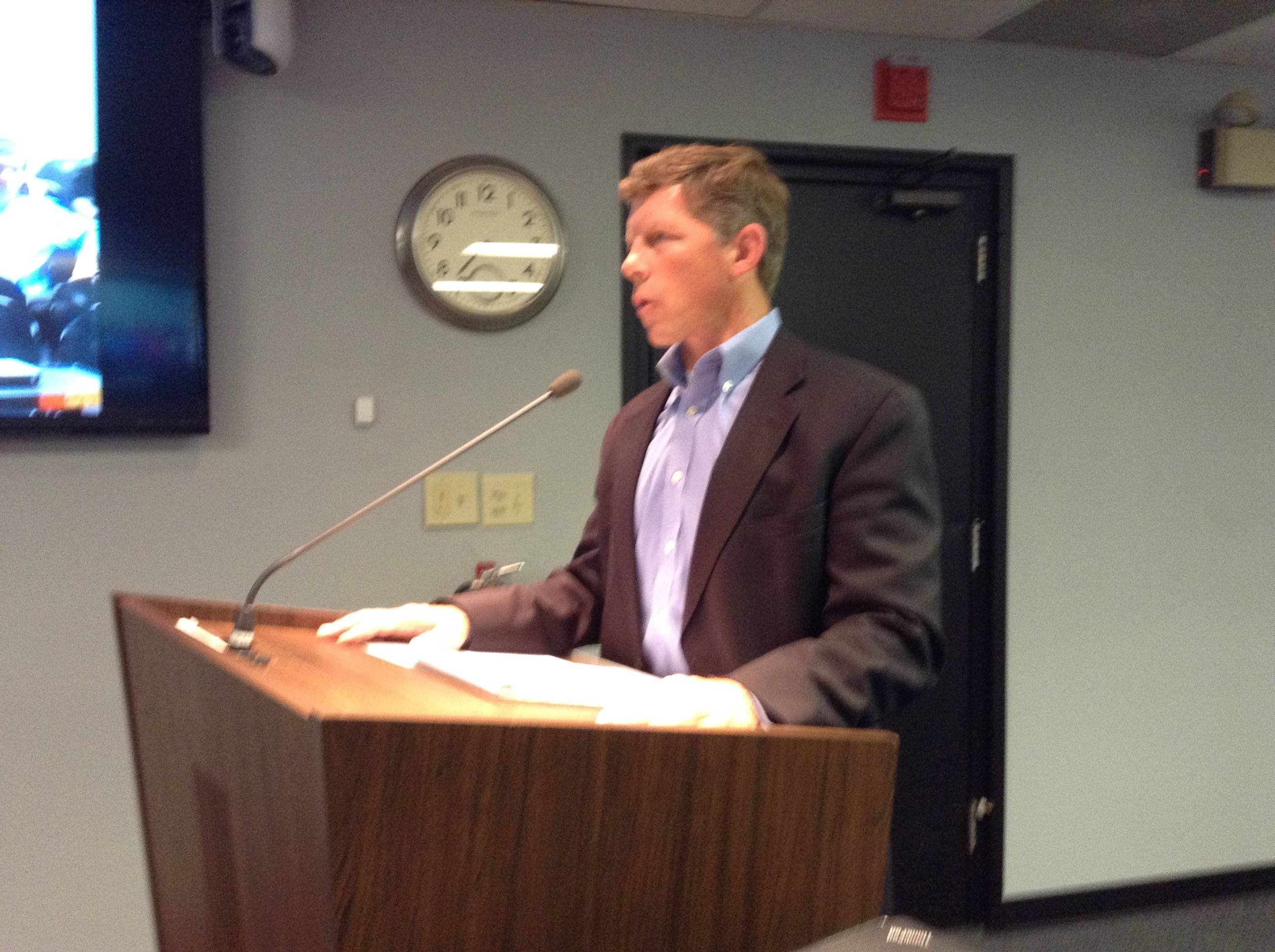 Lake Zurich Area Chamber of Commerce Executive Director Dale Perrin addresses the Lake Zurich village board about home rule Monday night.