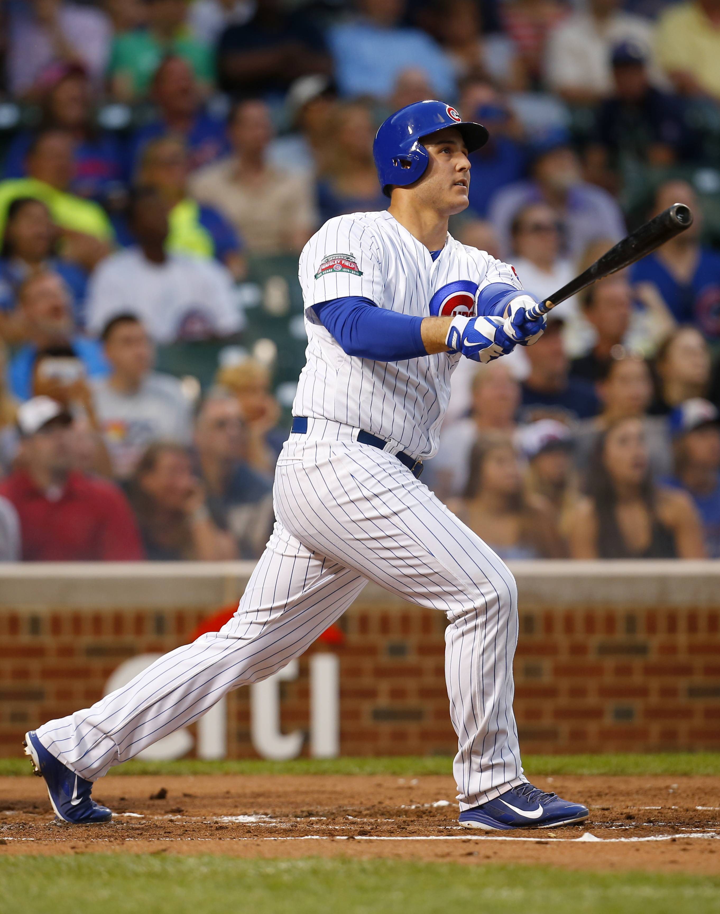Cubs' Anthony Rizzo watches his two-run home run during the first inning of a baseball game against San Francisco Giants in Chicago, Tuesday, Aug. 19, 2014.