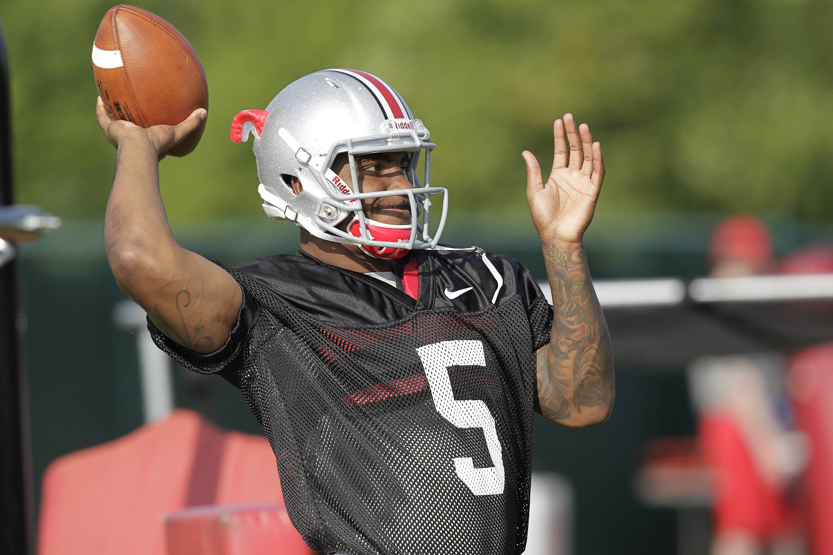 Ohio State quarterback Braxton Miller, among the top contenders for the Heisman Trophy, reportedly reinjured his throwing shoulder Monday during practice. The report about the two-time Big Ten offensive player of the year comes with just more than two weeks before the No. 5 Buckeyes open the season.