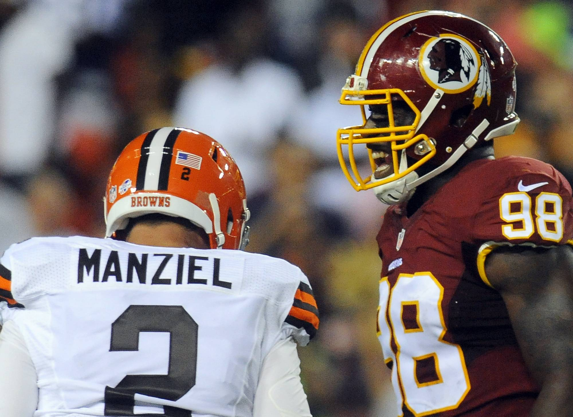 Washington linebacker Brian Orakpo (98) reacts after Cleveland quarterback Johnny Manziel was sacked during Monday's preseason game in Landover, Md.