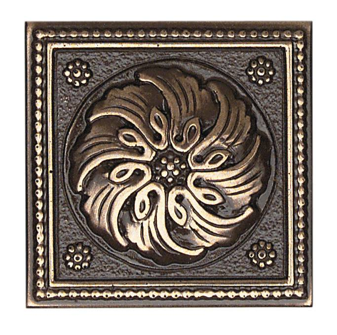 Daltile's Celtic tile, found at allmodern.com, has a polished bronze finish that gives it the illusion of age. Use a single tile as wall art or on a mantel, or use as accents in a renovated space.