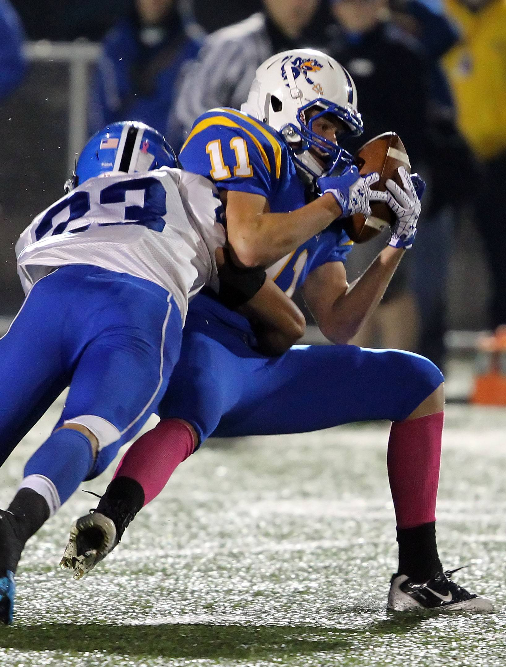 Players from Warren and Lake Zurich high schools clash in a 2012 game.