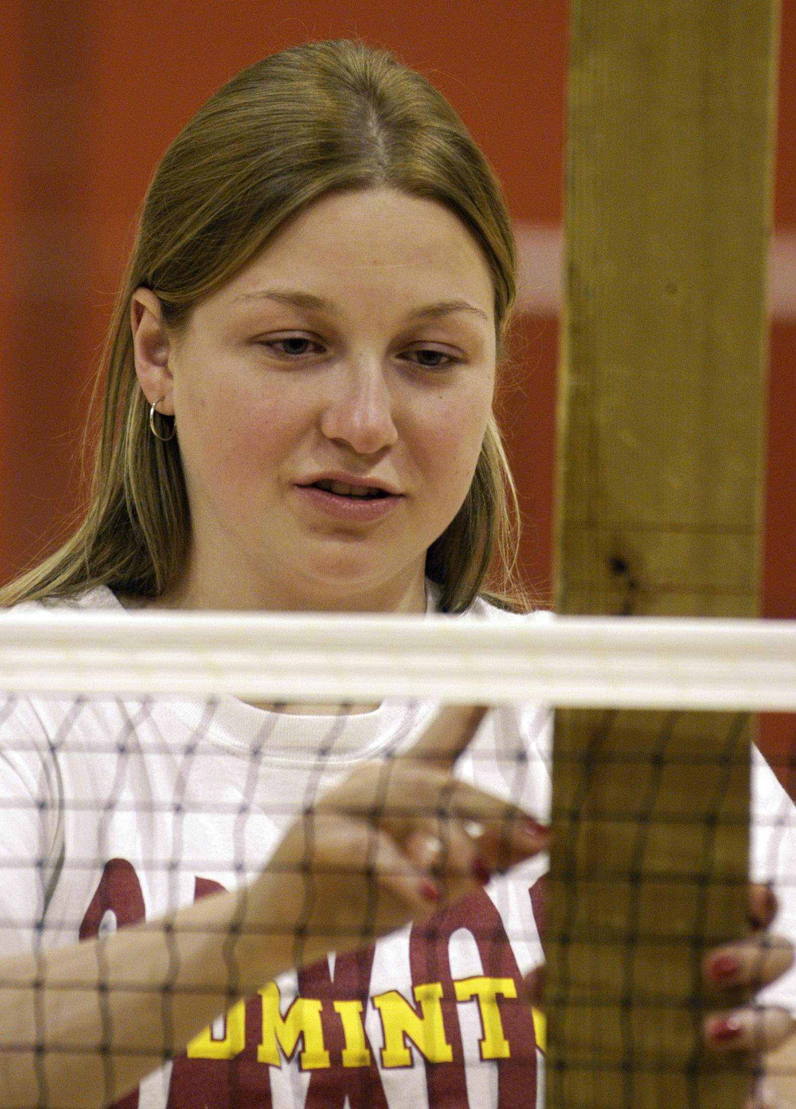 Joanna Sojka, a senior at Schaumburg High School in 2003 and a member of the school's badminton team, checks the height of the net. She was valedictorian of her class and named to the Daily Herald Academic Team.