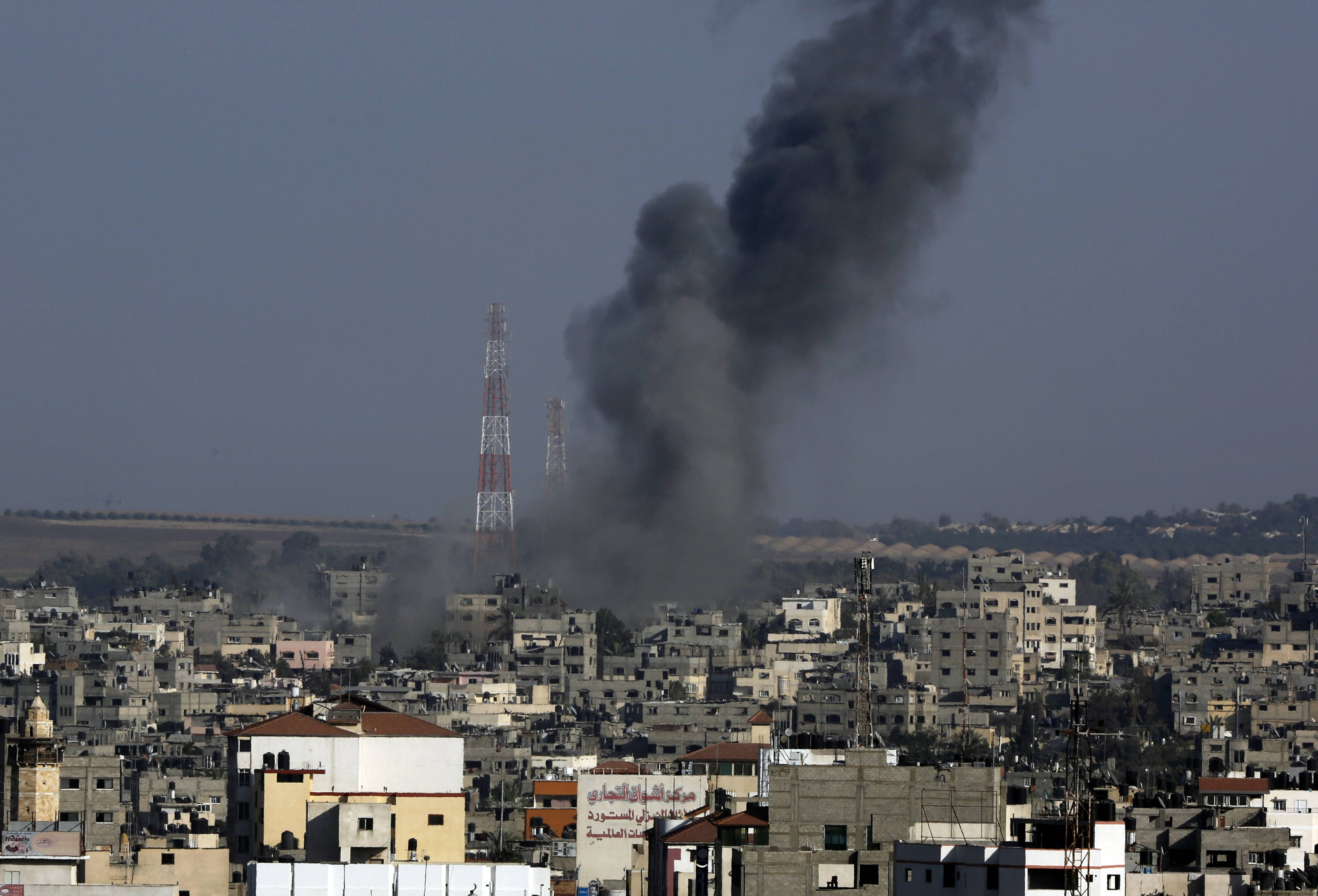 Smoke rises after an Israeli strike hit Gaza City in the northern Gaza Strip, Tuesday, The Israeli military said it carried out a series of airstrikes Tuesday across the Gaza Strip in response to renewed rocket fire, a burst of violence that broke a temporary cease-fire.
