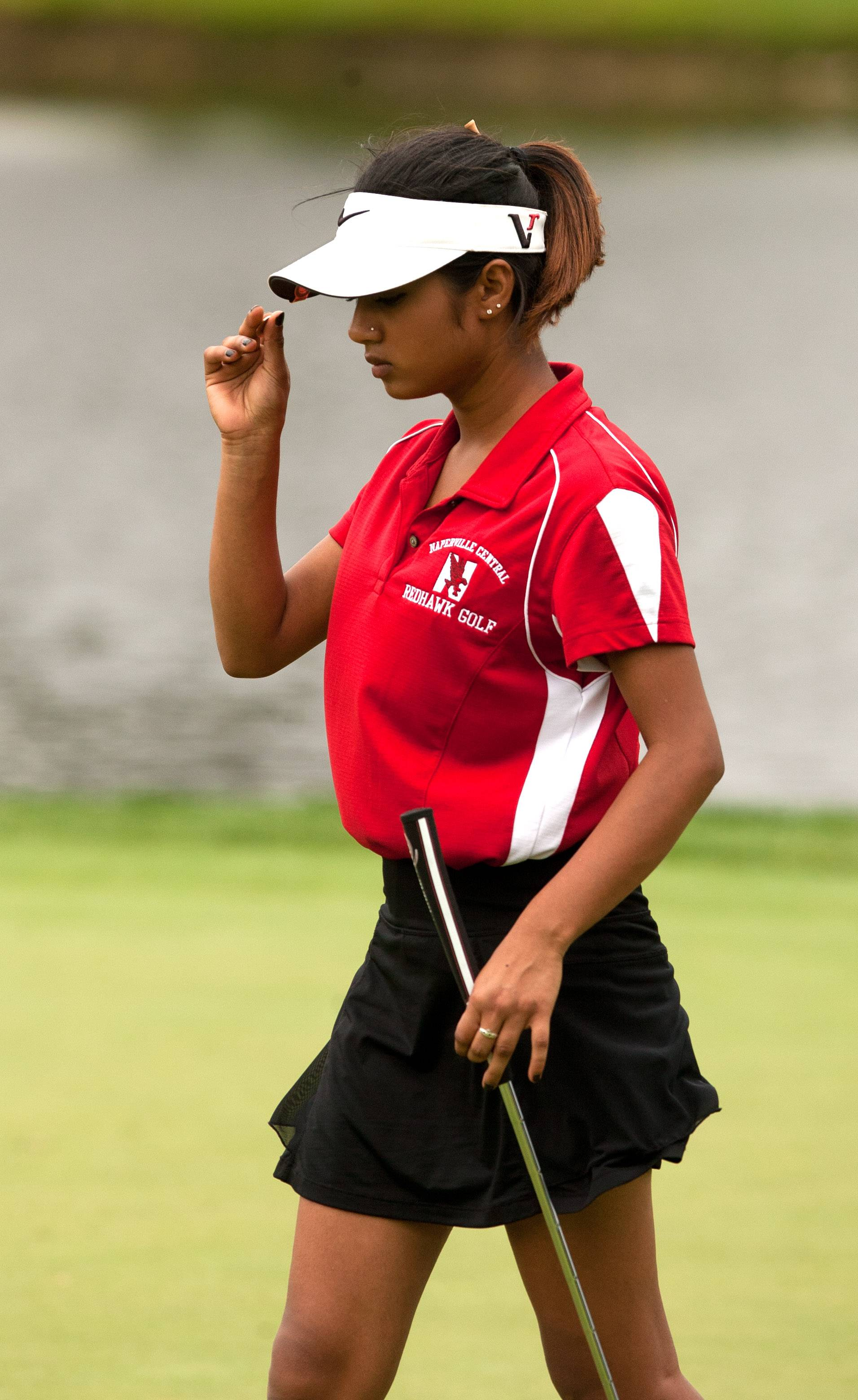 Naperville Central's Riya Anand walks the green during the Vern McGonagle Memorial High School Golf Championship at the Naperville Country Club.